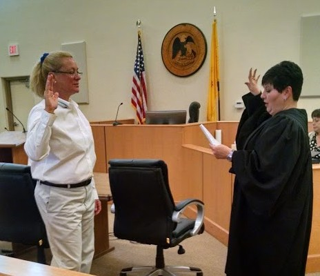 New CASA Volunteer Lisa Todd is sworn in by Judge Murphy.