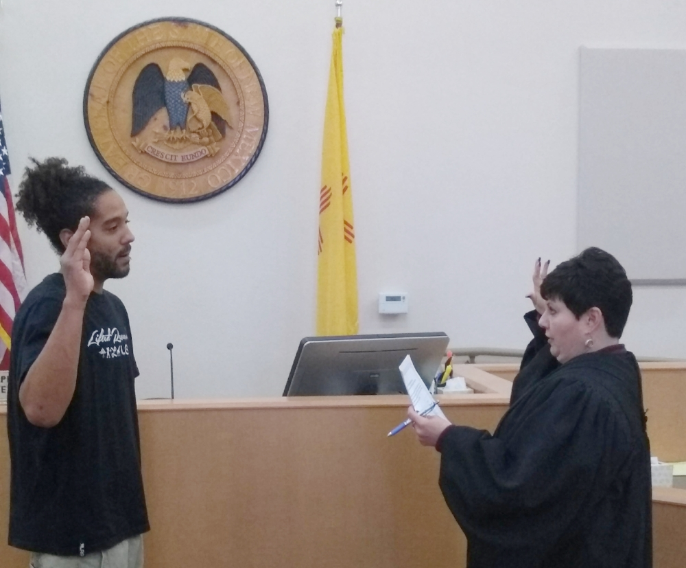 Volunteer Blair Davidson sworn in by Judge Mercedes Murphy