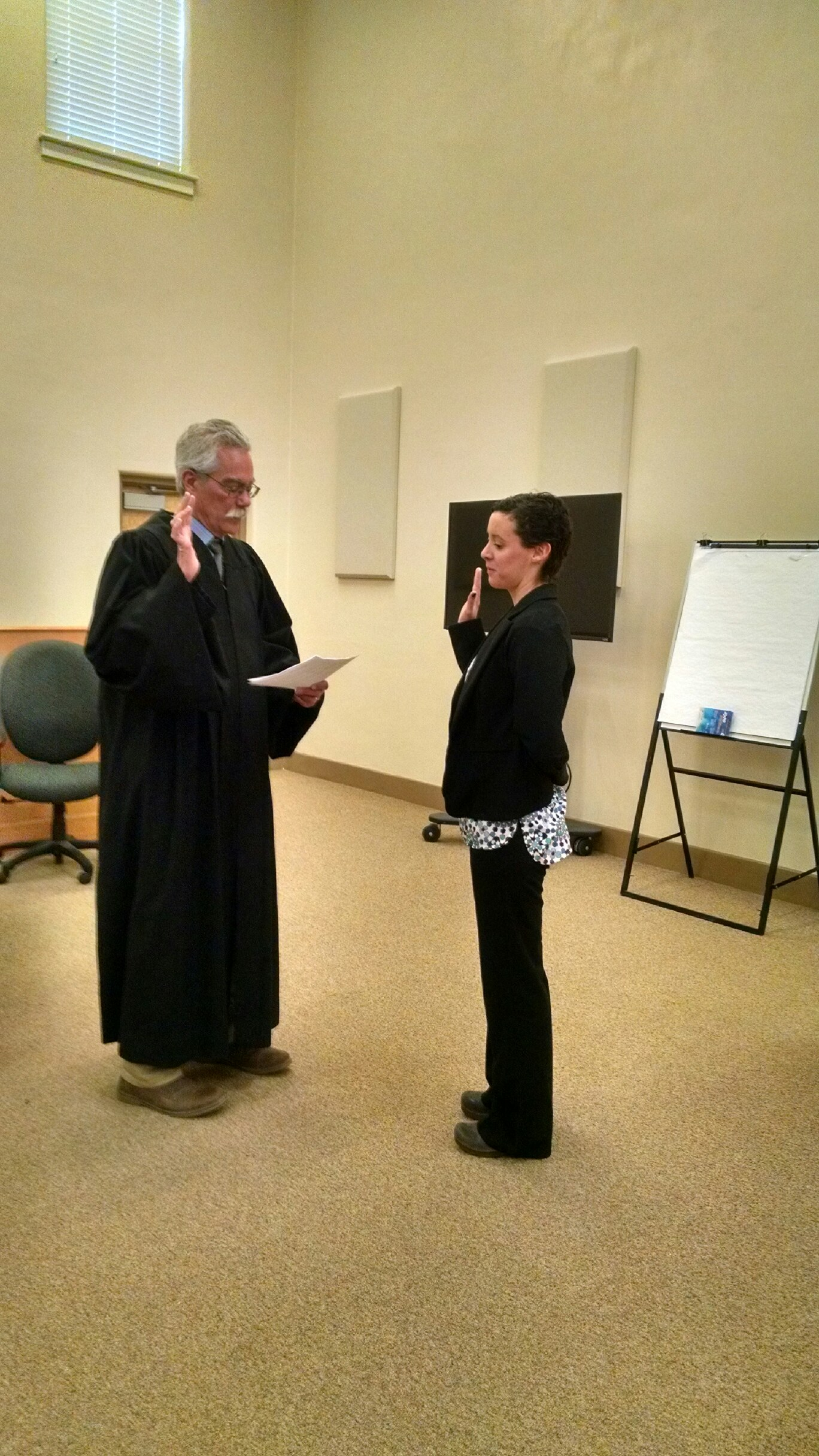 Volunteer Maria Weir is sworn in by Judge Matthew Reynolds.