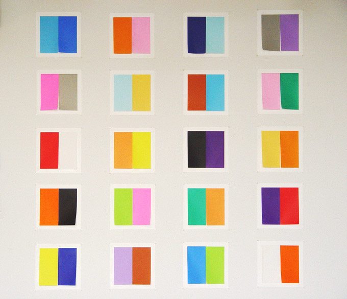 """2 Color Squares,  2006, origami on paper, 11"""" x 11"""" each."""