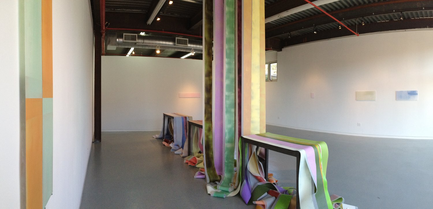 Hue[s]pace at ODETTA gallery  ,  Hue, Space, Place, A Year of Color, 14x 23 x 5 feet, acrylic on polyester resin film, tables, 2016. Image courtesy of Debra Ramsay.