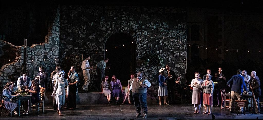 Keel Watson as  Baldassare  and the Opera Holland Park Chorus  L'ARLESIANA  at Opera Holland Park, July 2019 Photo: Ali Wright