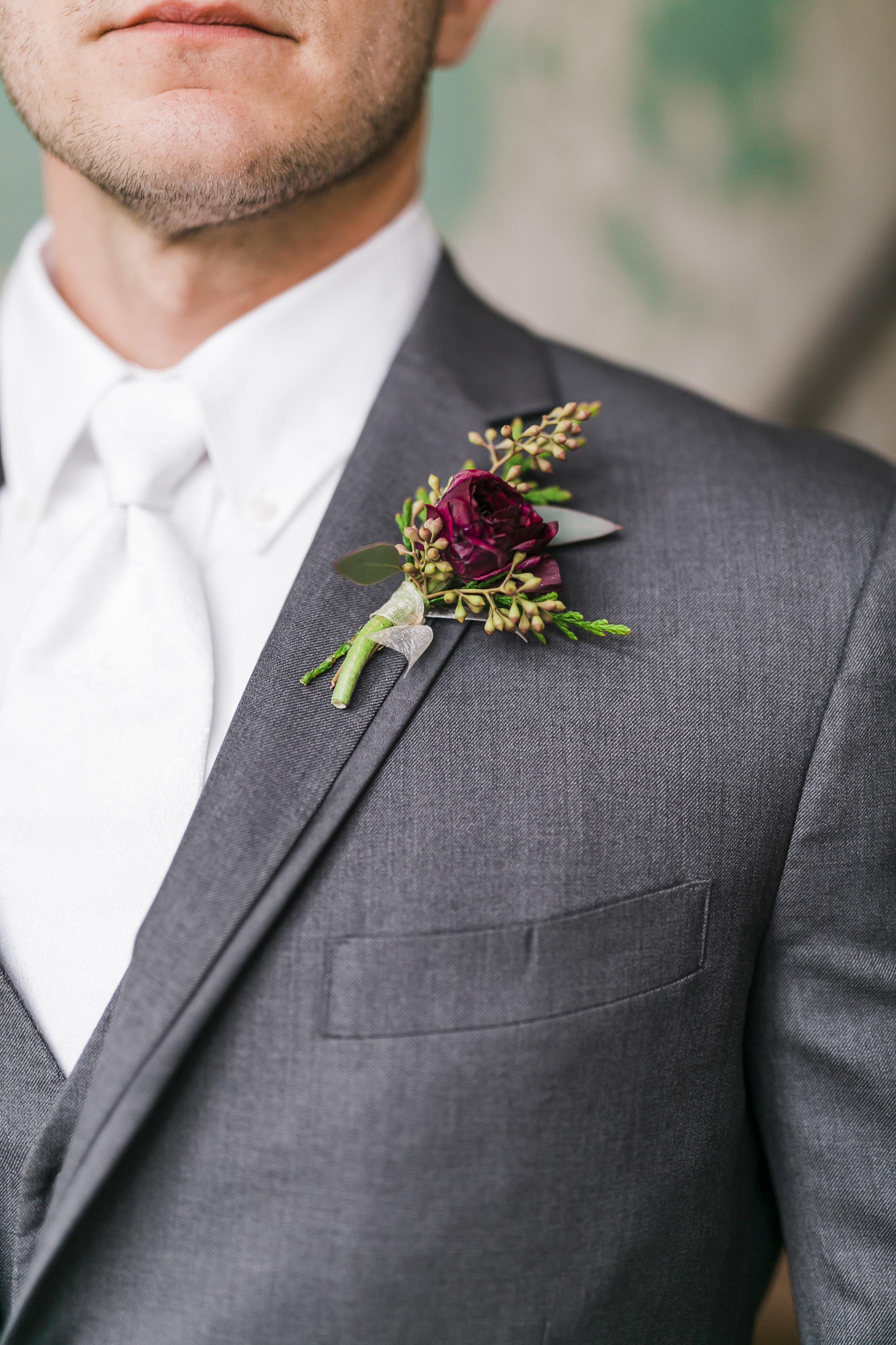 groom maroon flowers
