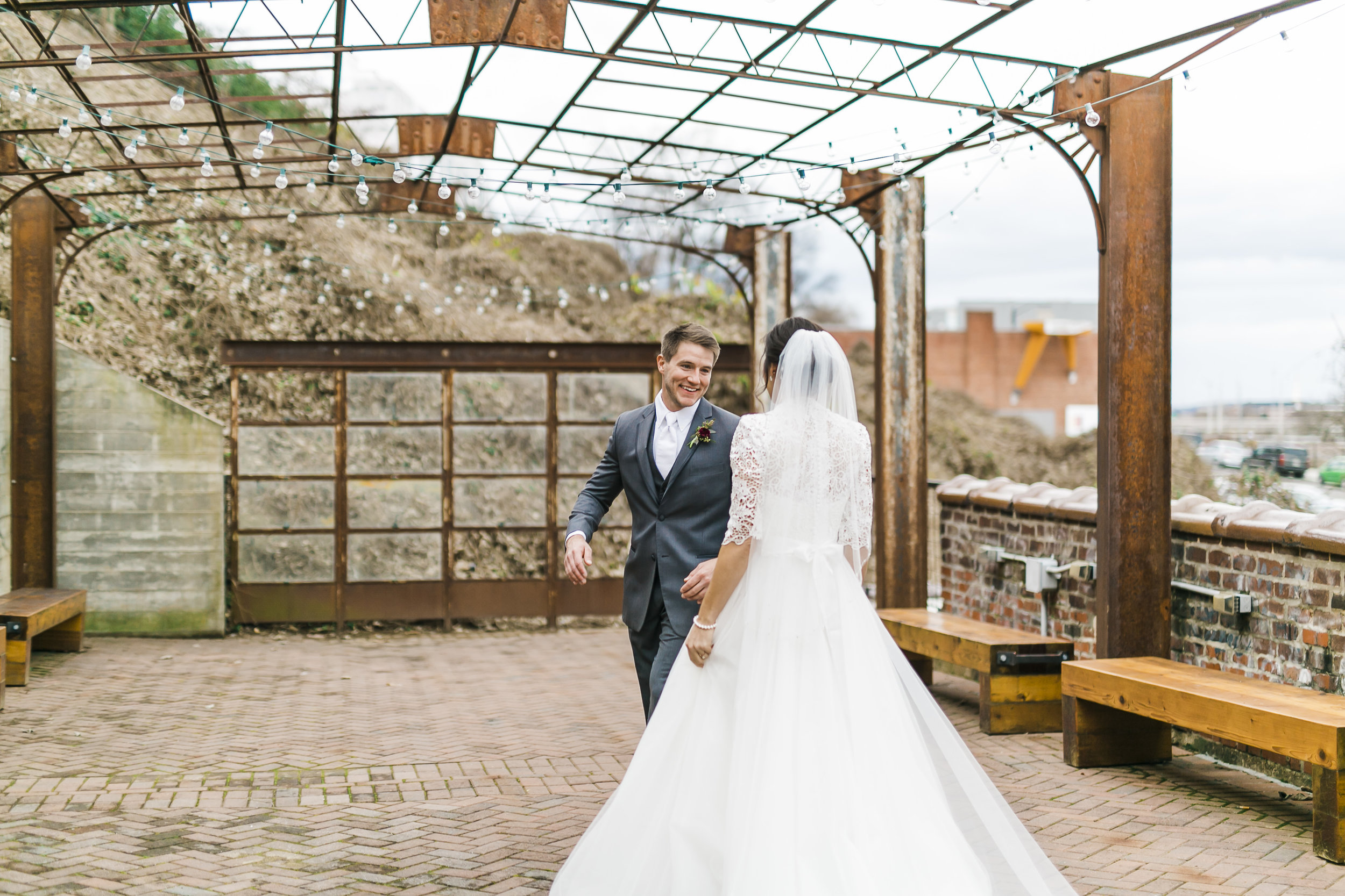 bride and groom first look winter wedding outdoors on patio of the standard downtown knoxville