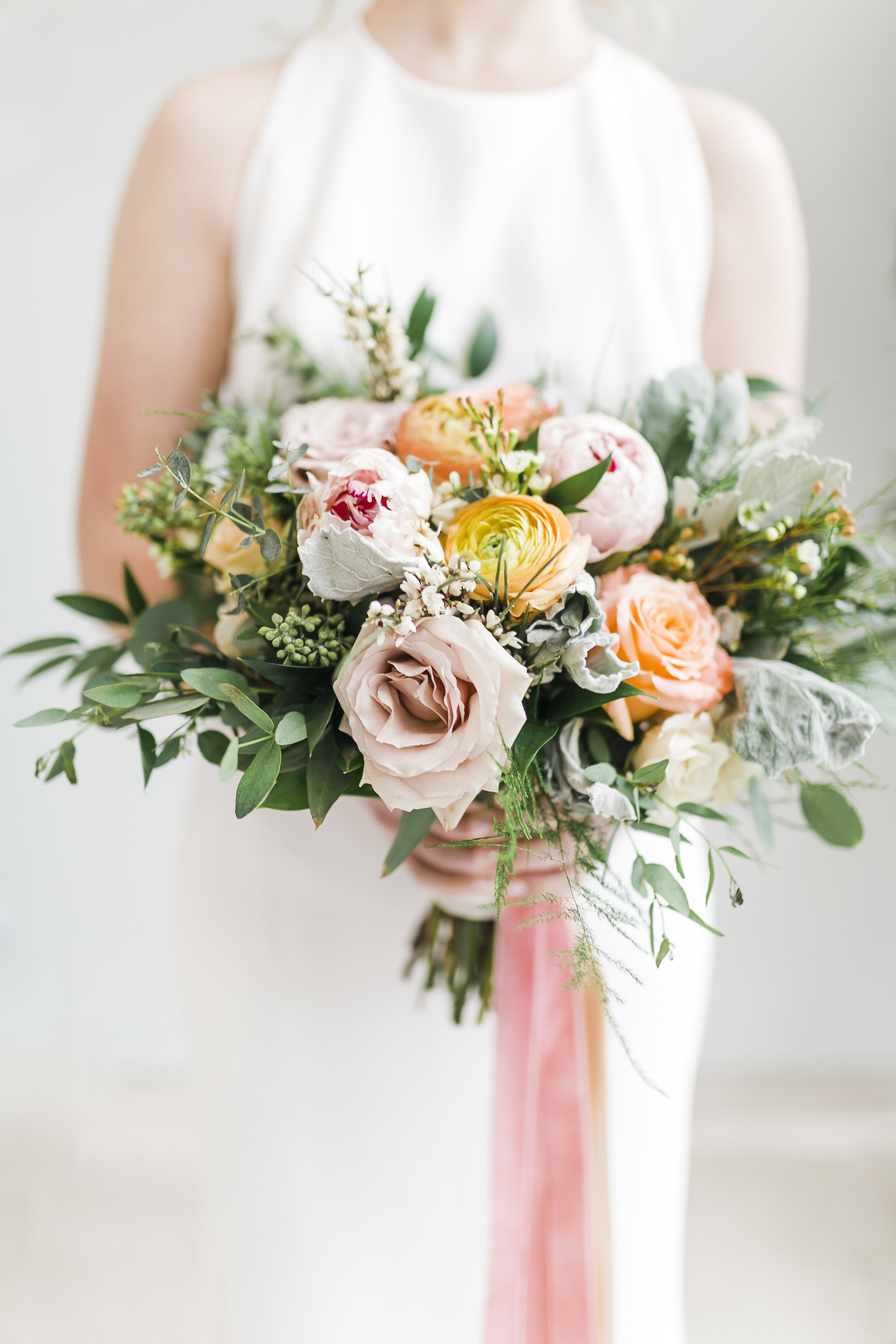 ranunculus and peony bouquet with pink and coral ribbons lb floral