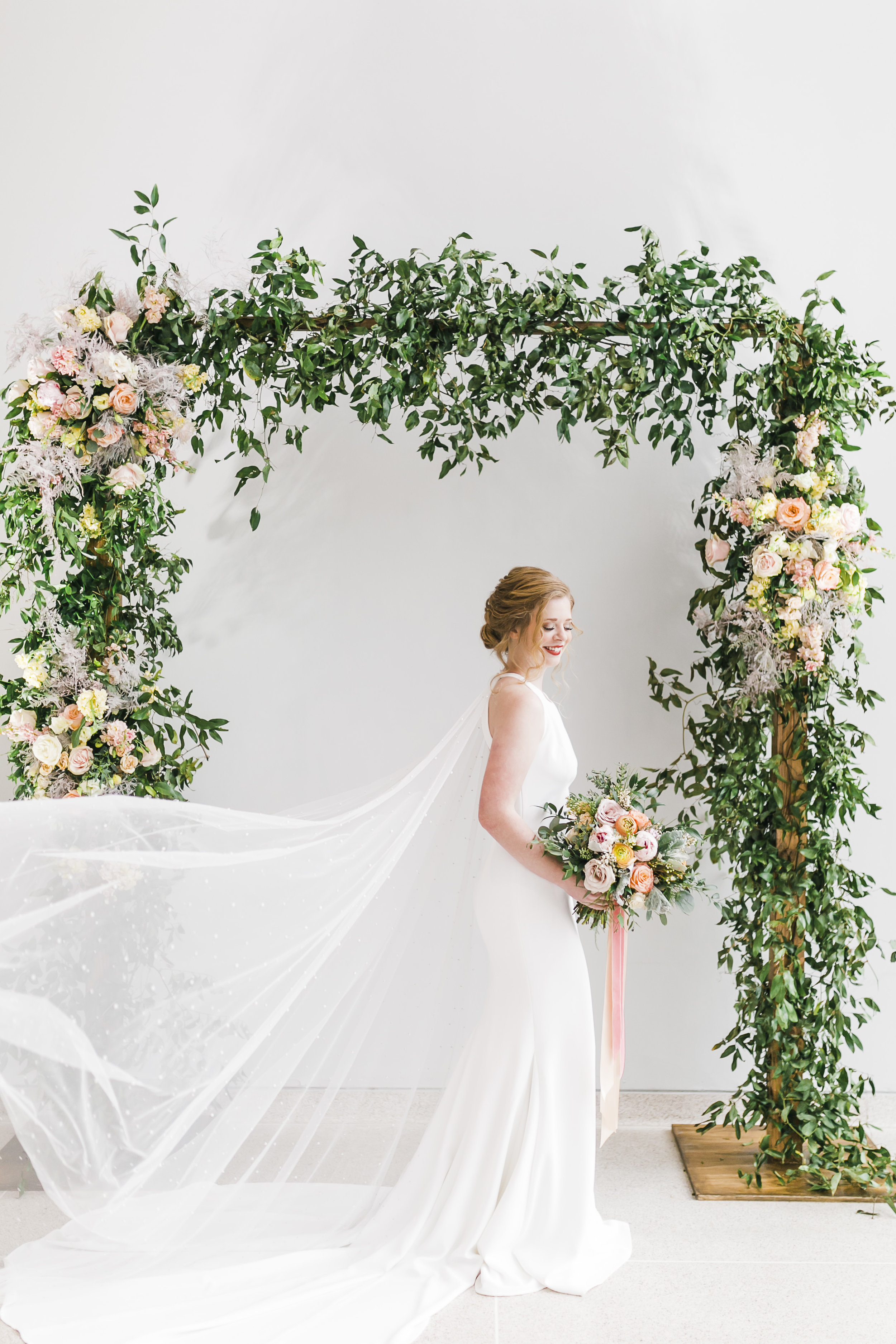 floral arch with bride in classic dress at knoxville museum of art with lb floral