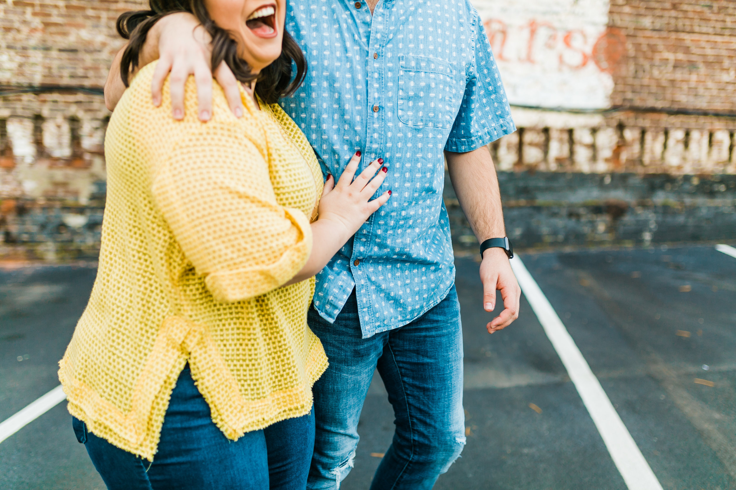 couple laughing engagement photos