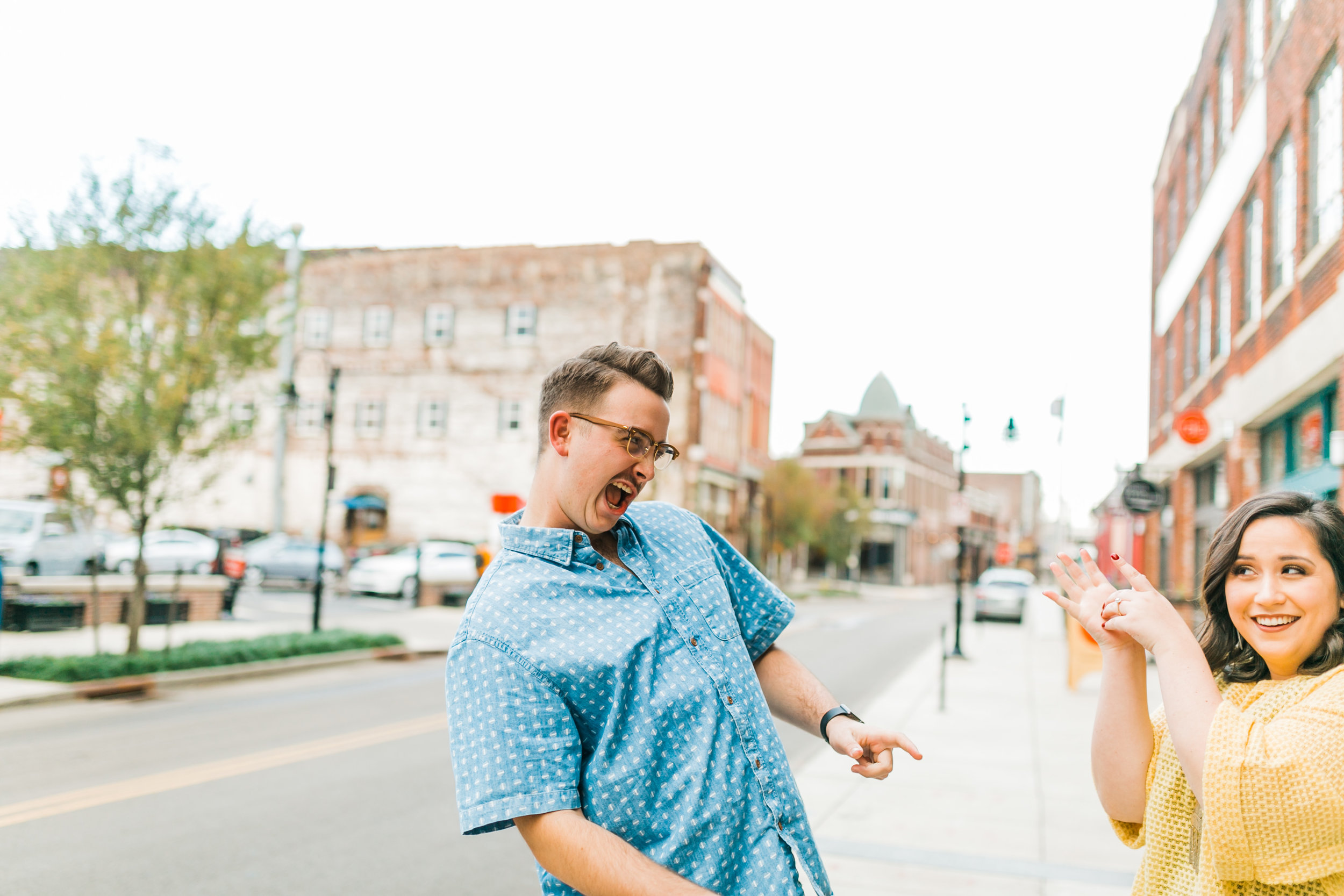 couple playing in downtown knoxville engagement photos