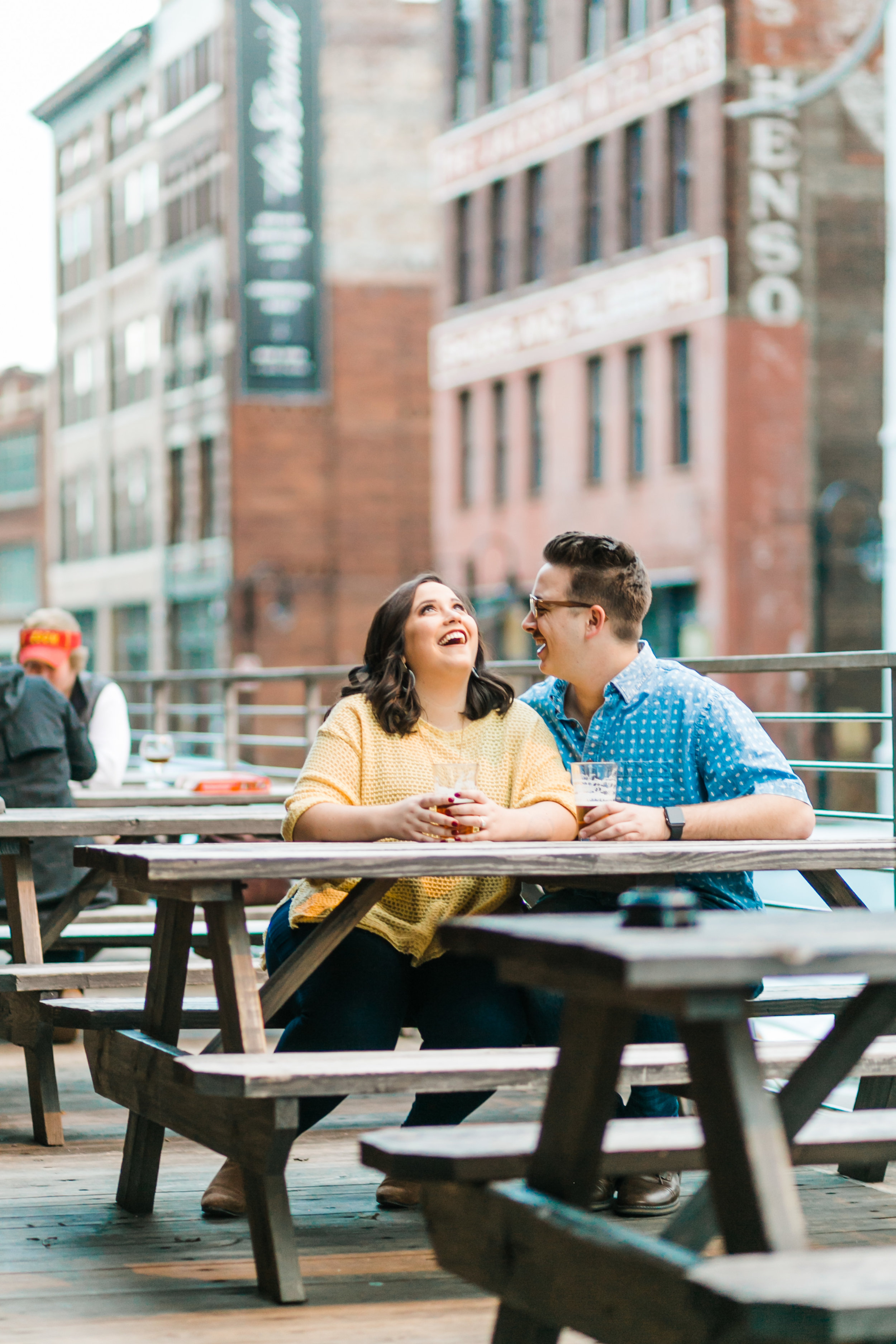 couple drinking engagement photos downtown knoxville taproom