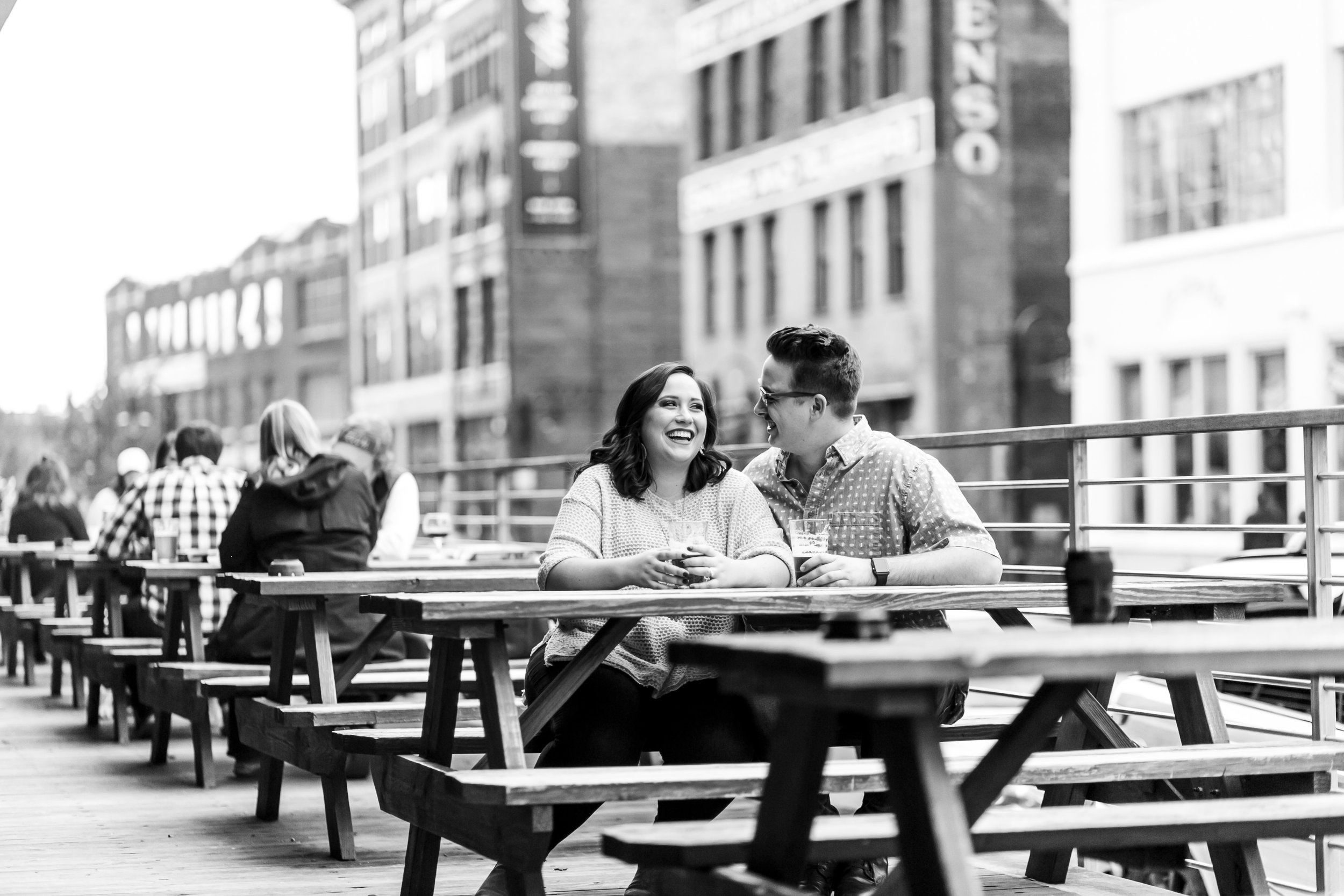 black and white old city downtown knoxville couple engagement session drinking pour taproom