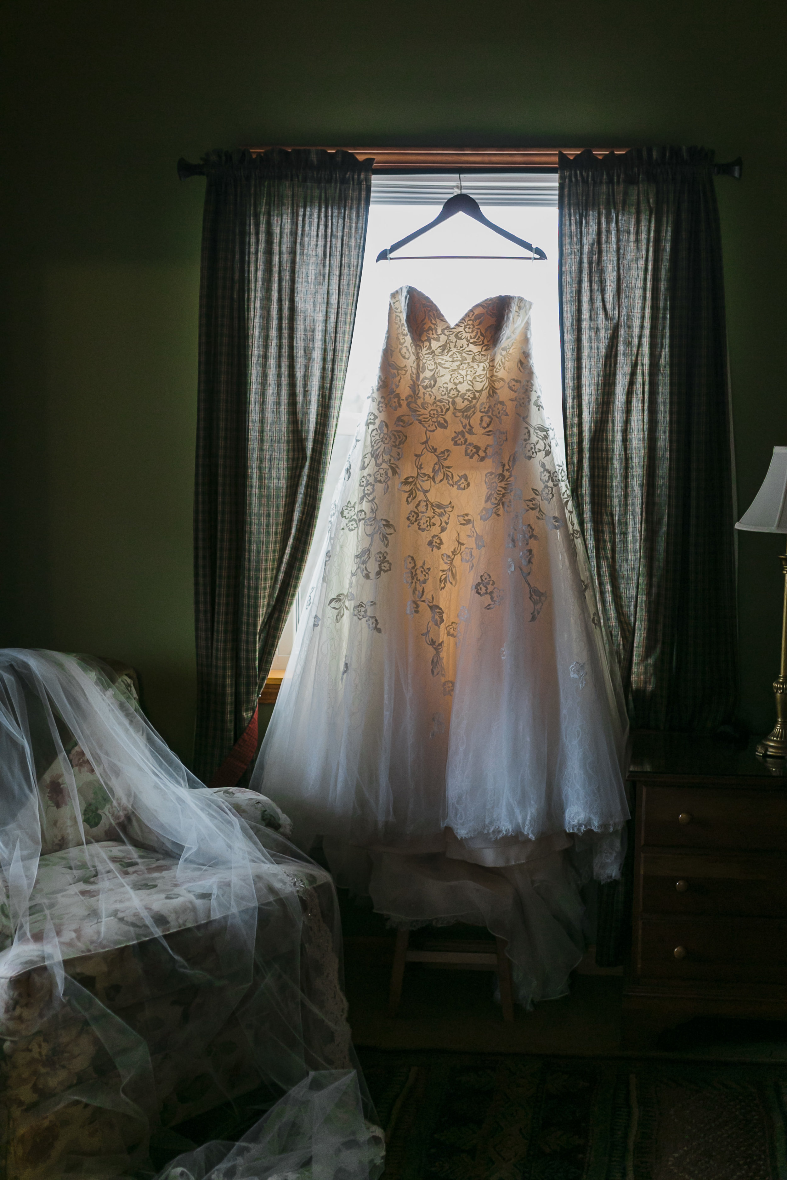 dress hanging in window peach colored