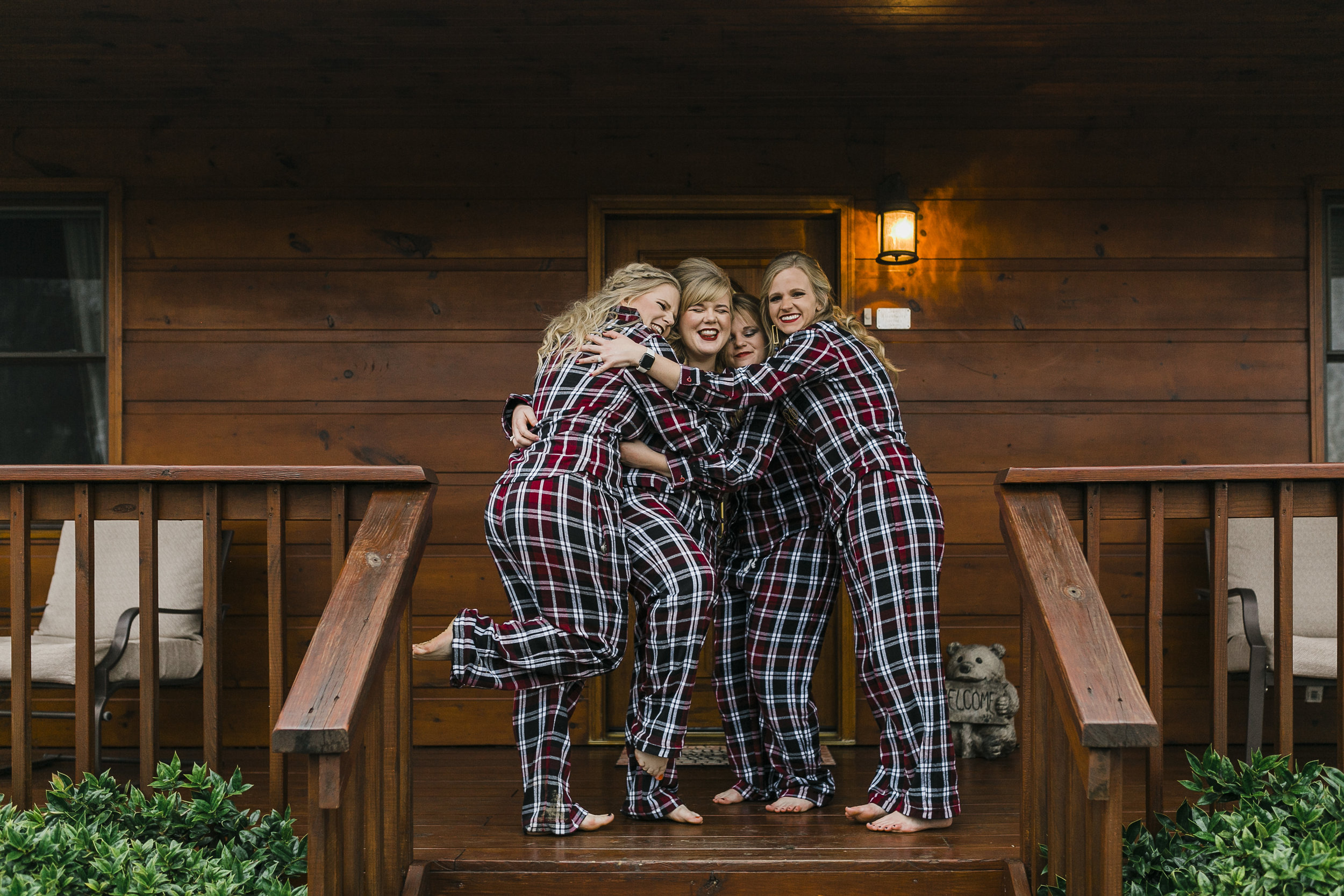 blonde bridesmaids in flannel pajamas at berry spring lodge