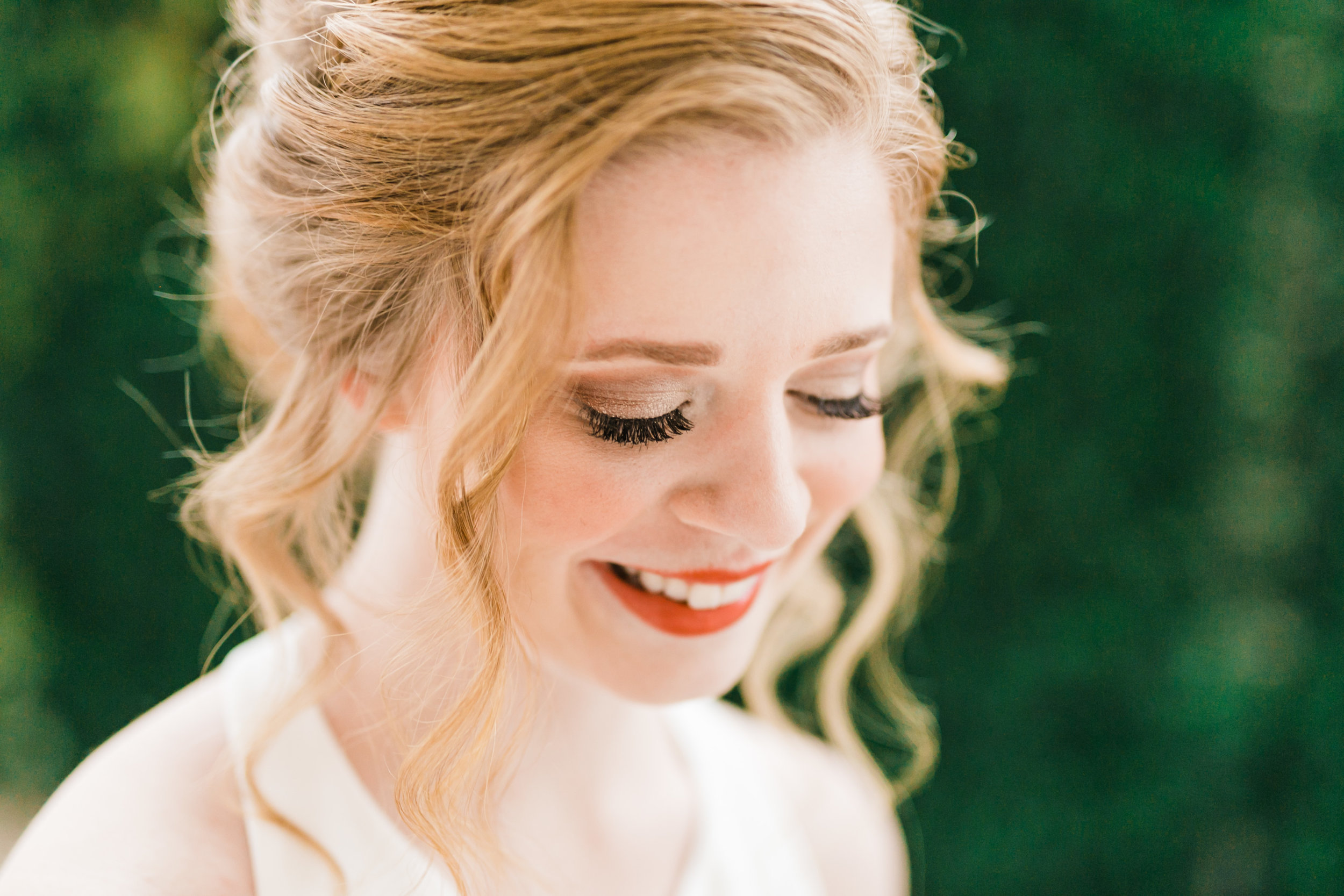 classic glam makeup on fair complexion bride with red hair