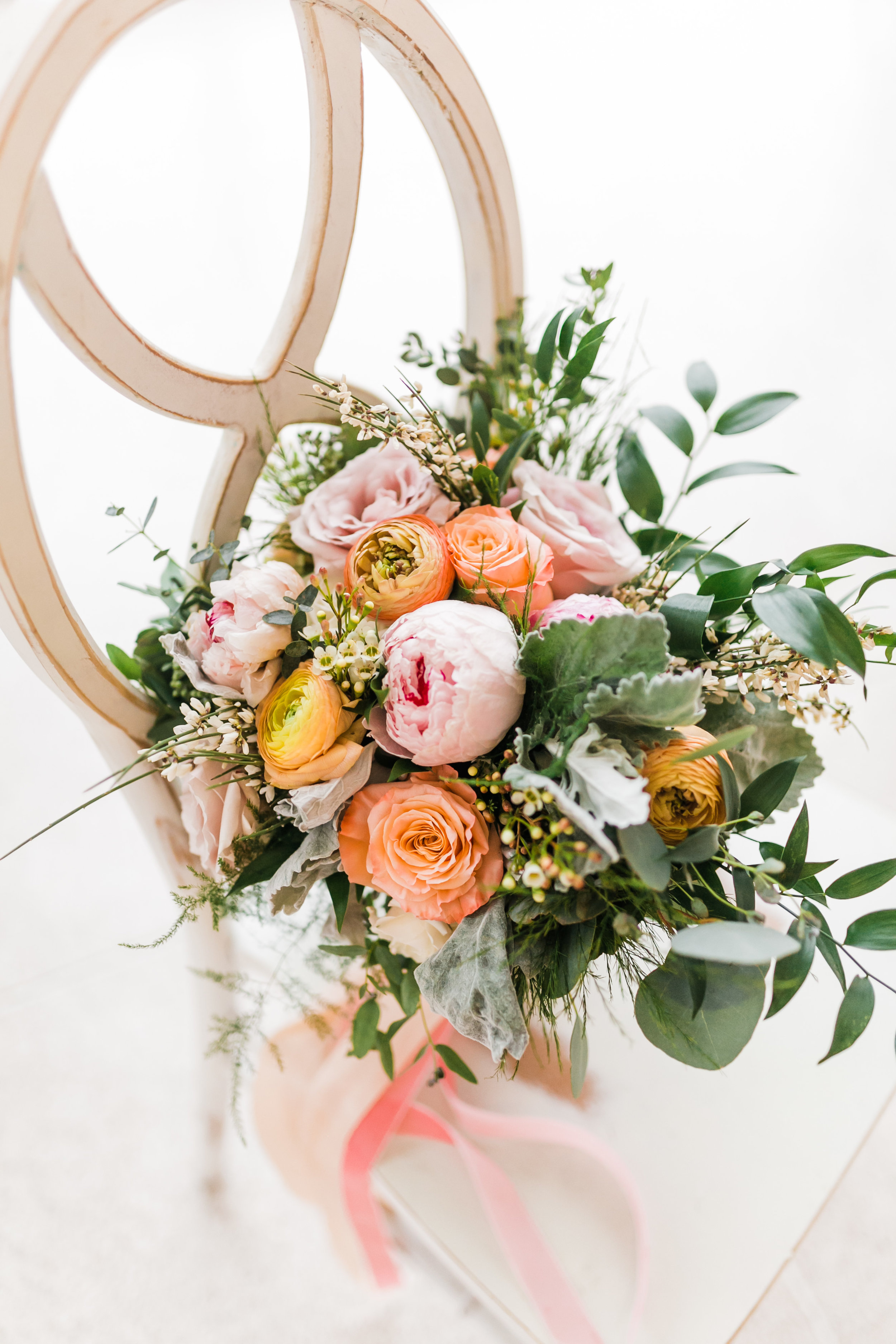 spring bouquet with peony and rannuculus and roses in pink and orange