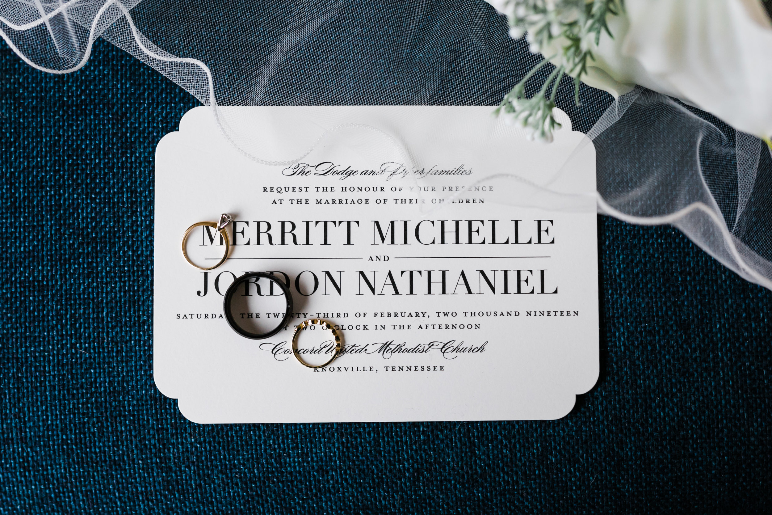 classic invitation suite styled with rings and veil