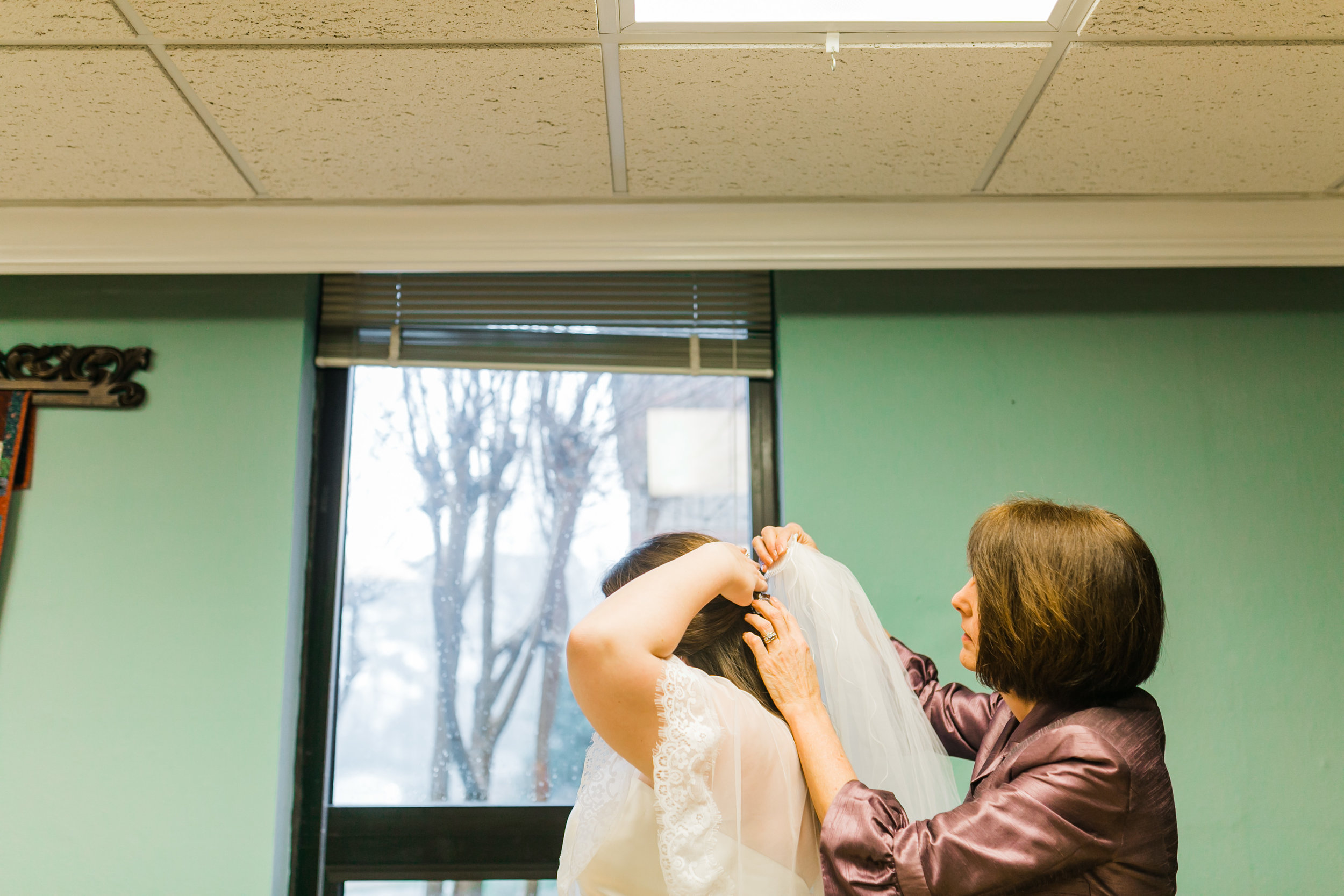 bride putting in veil in church dressing area concord united methodist