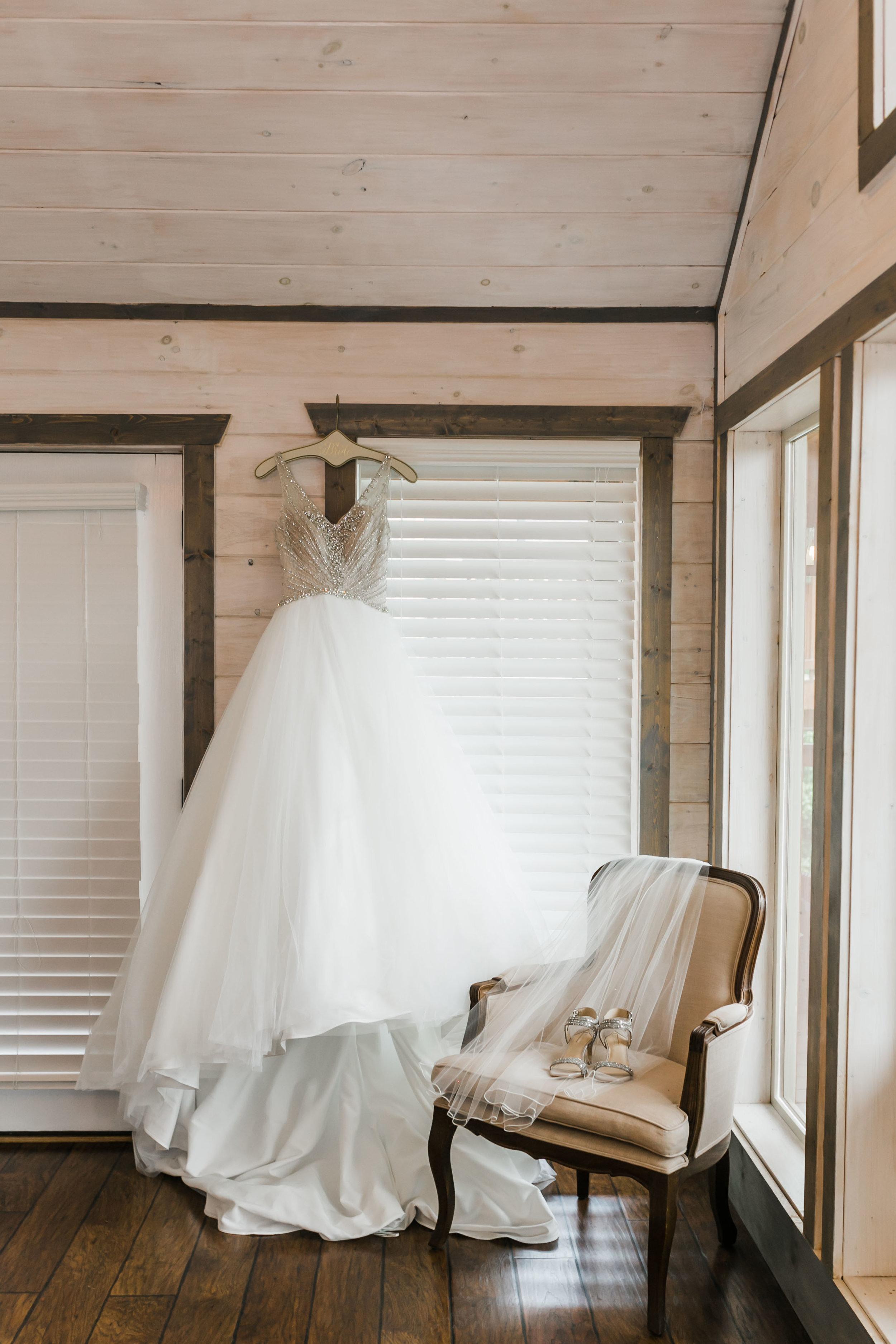 sottero and Midgley dress hanging magnolia venue bridal suite