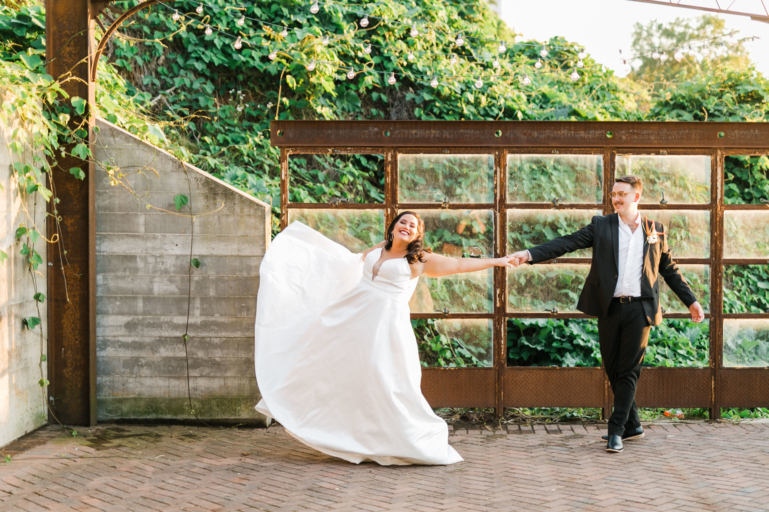 bride and groom twirling on rooftop at the standard patio knoxville summer