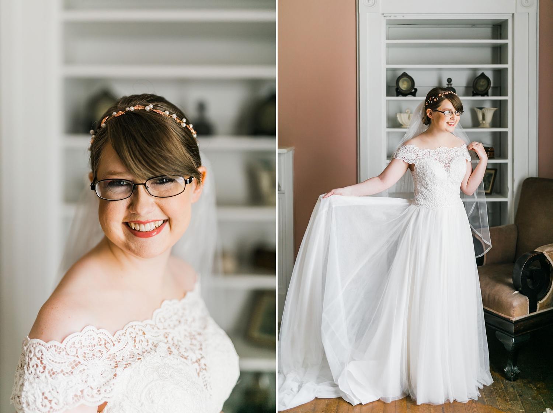 brunette bride with glasses in pink bridal suite at bleak house