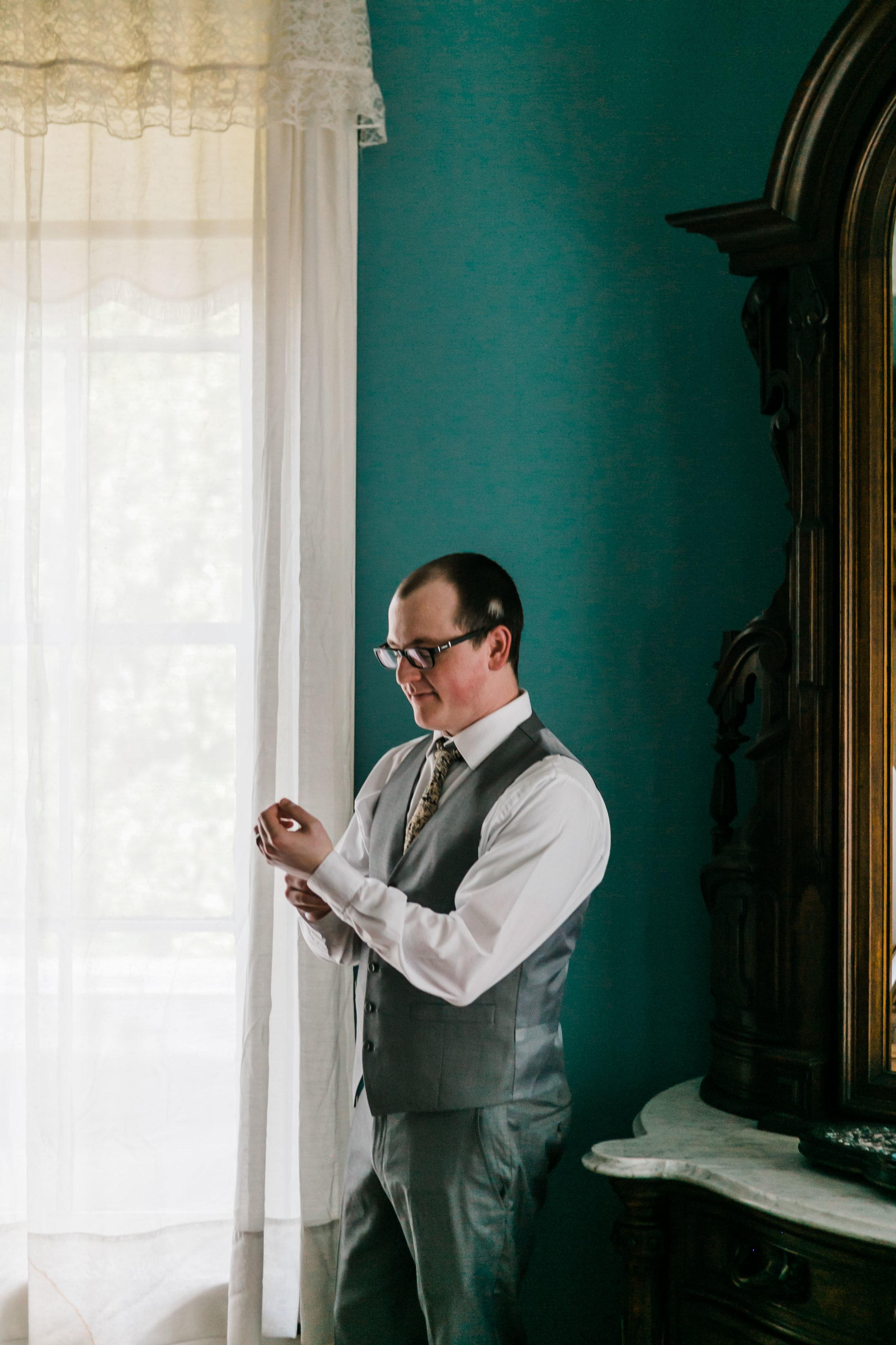 groom in teal room at bleak house