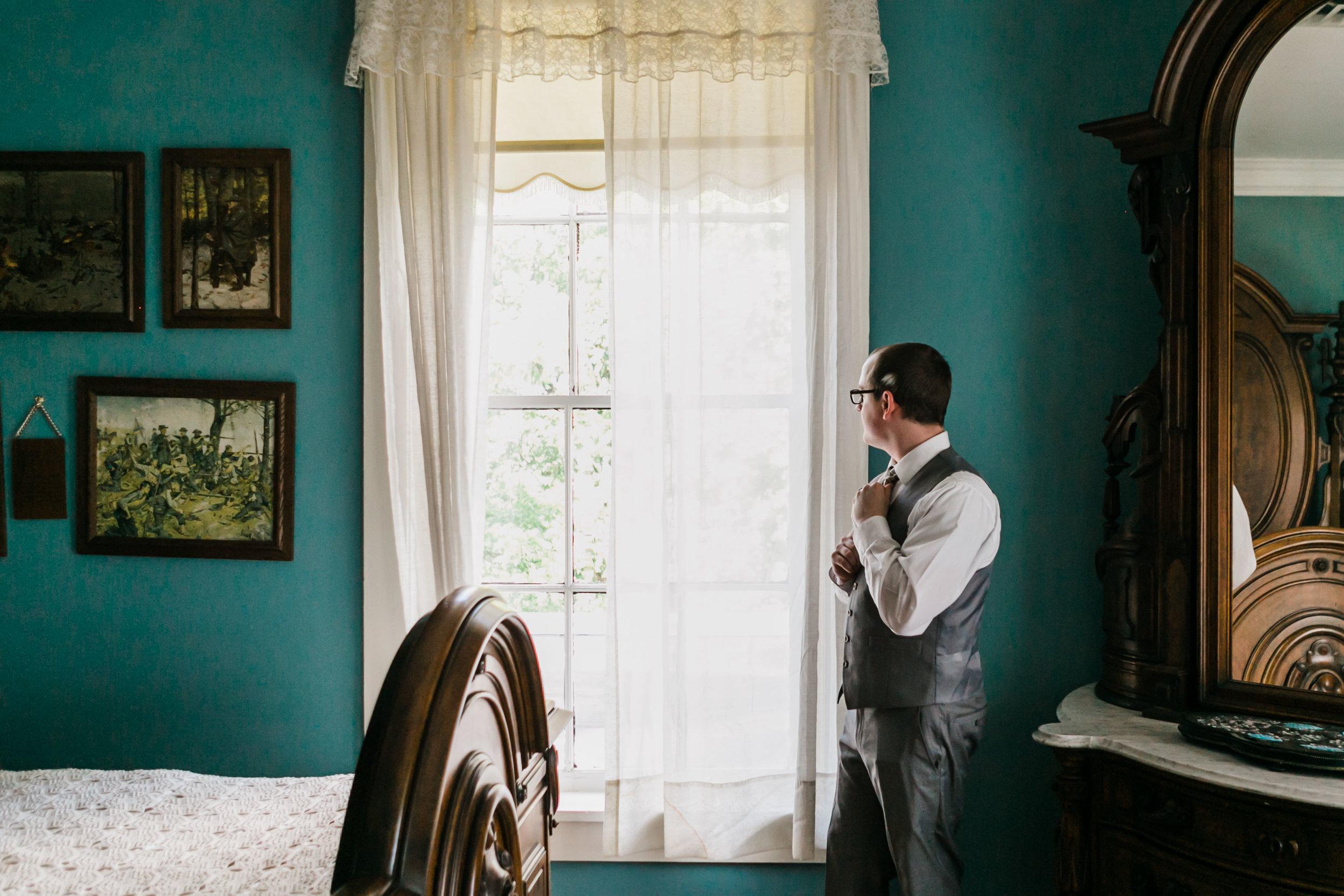 teal bedroom groom getting ready bleak house knoxville