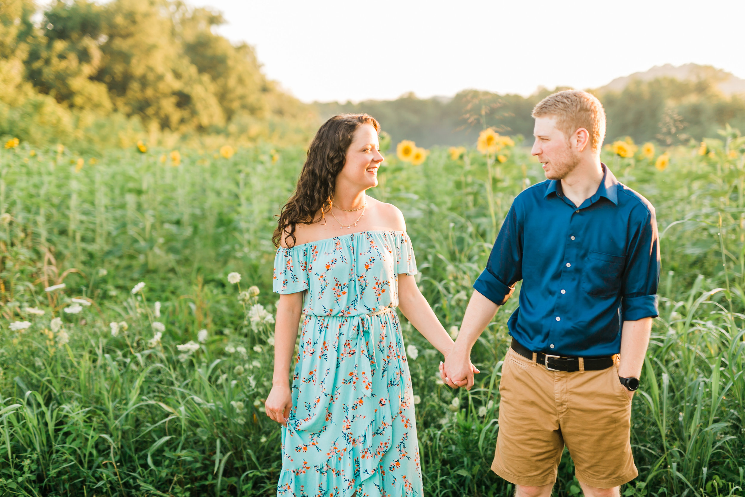 engagement photos in sunflower field blue outfits knoxville ijams