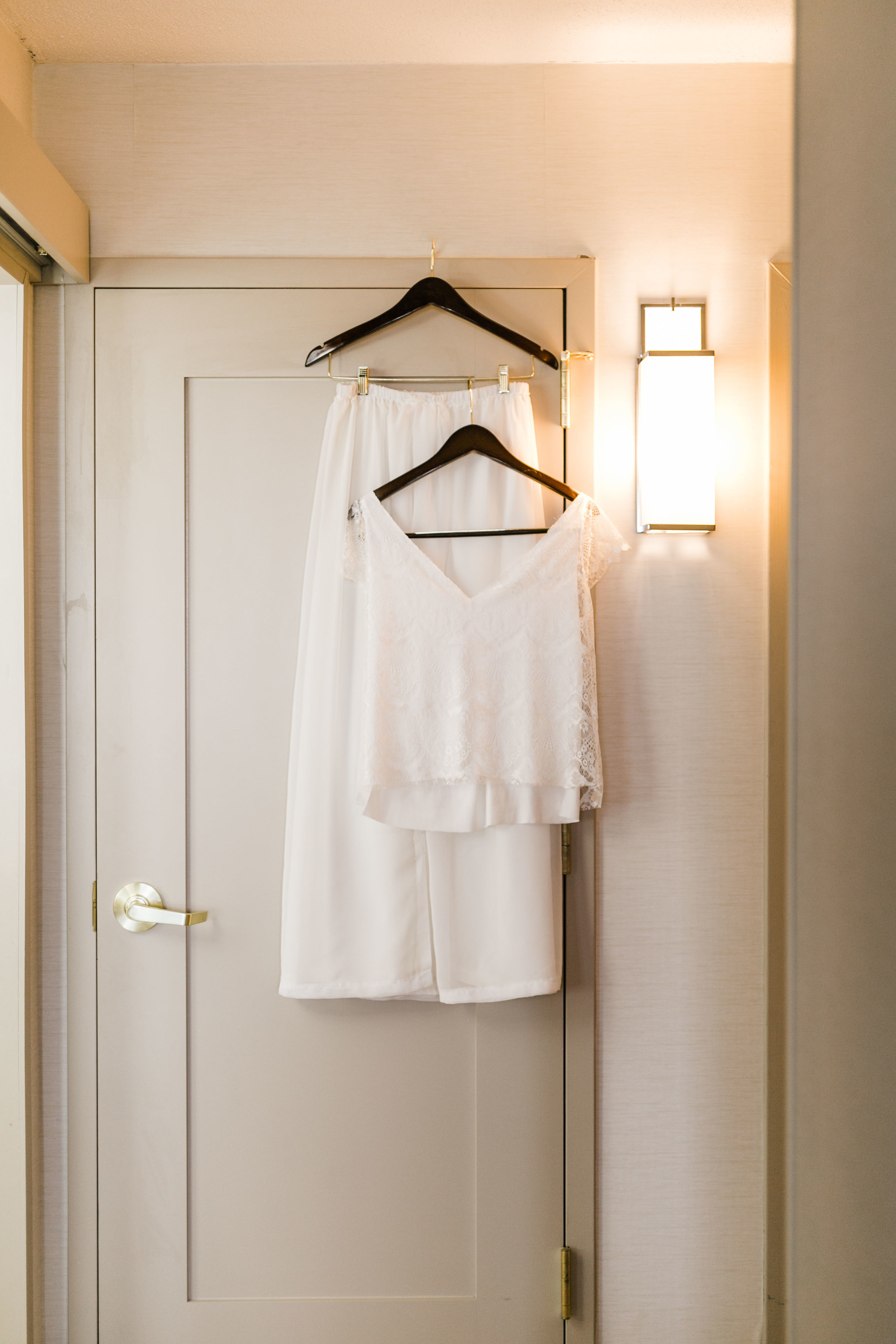 two piece diy wedding dress hanging in hotel room Hilton airport knoxville