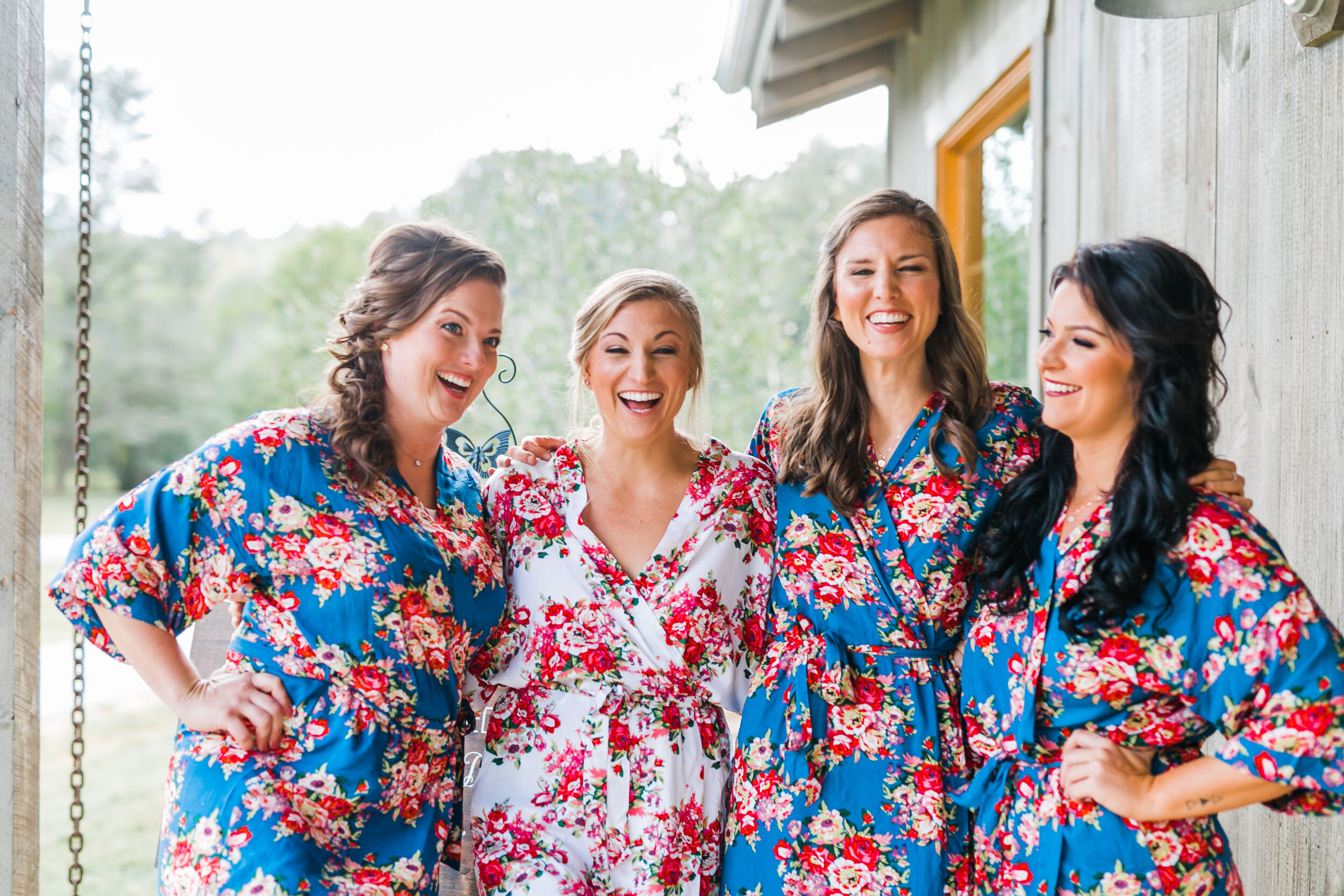 bridesmaids with bride in robes