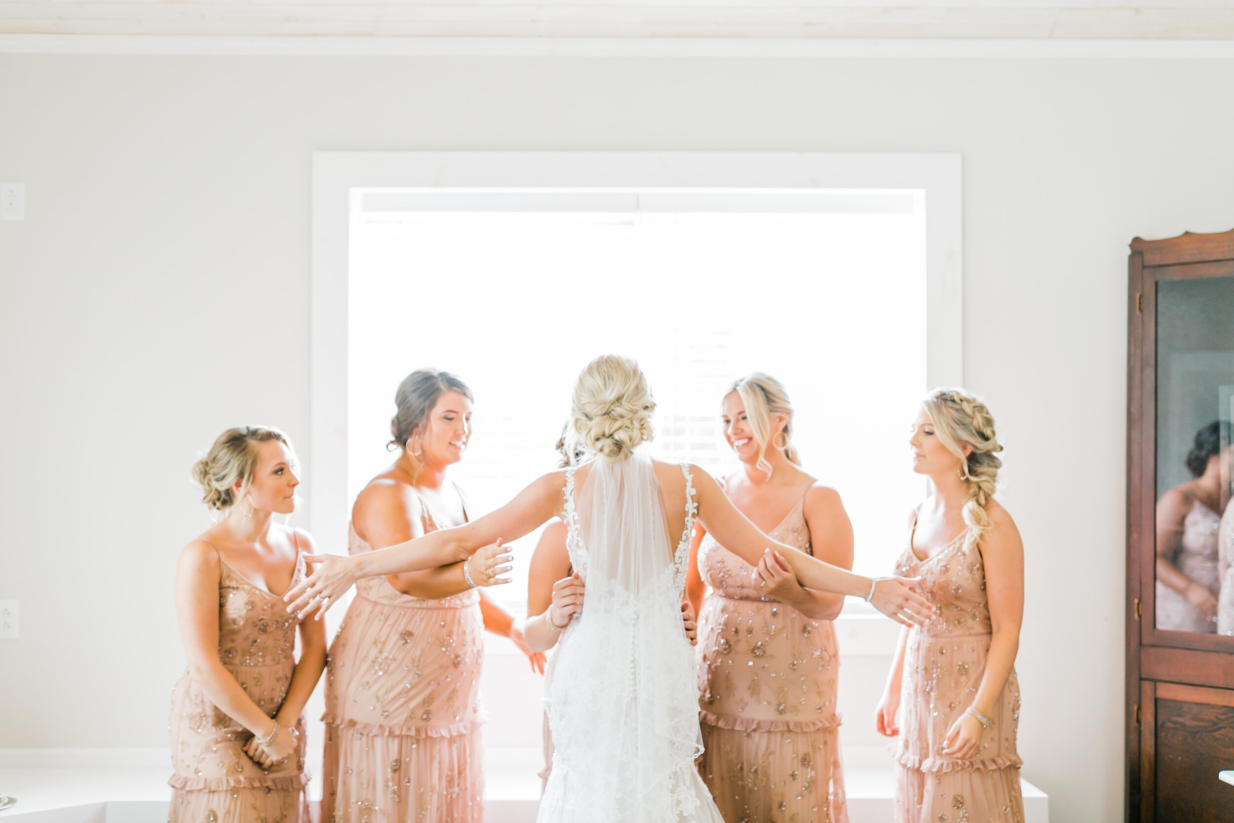 bridesmaid first look indoor bridal cottage barn at faith farms