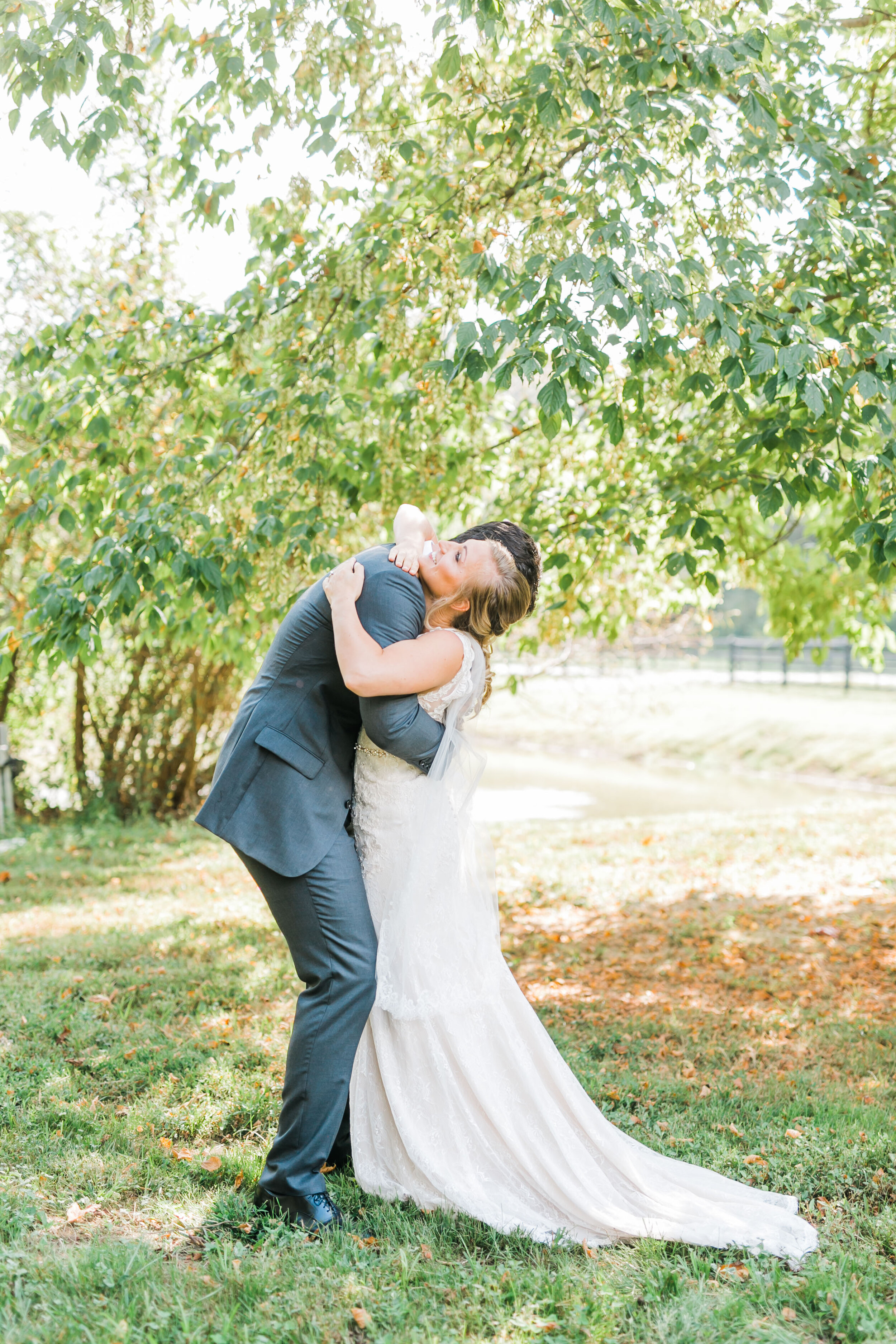 bride and groom hugging 4 points farm