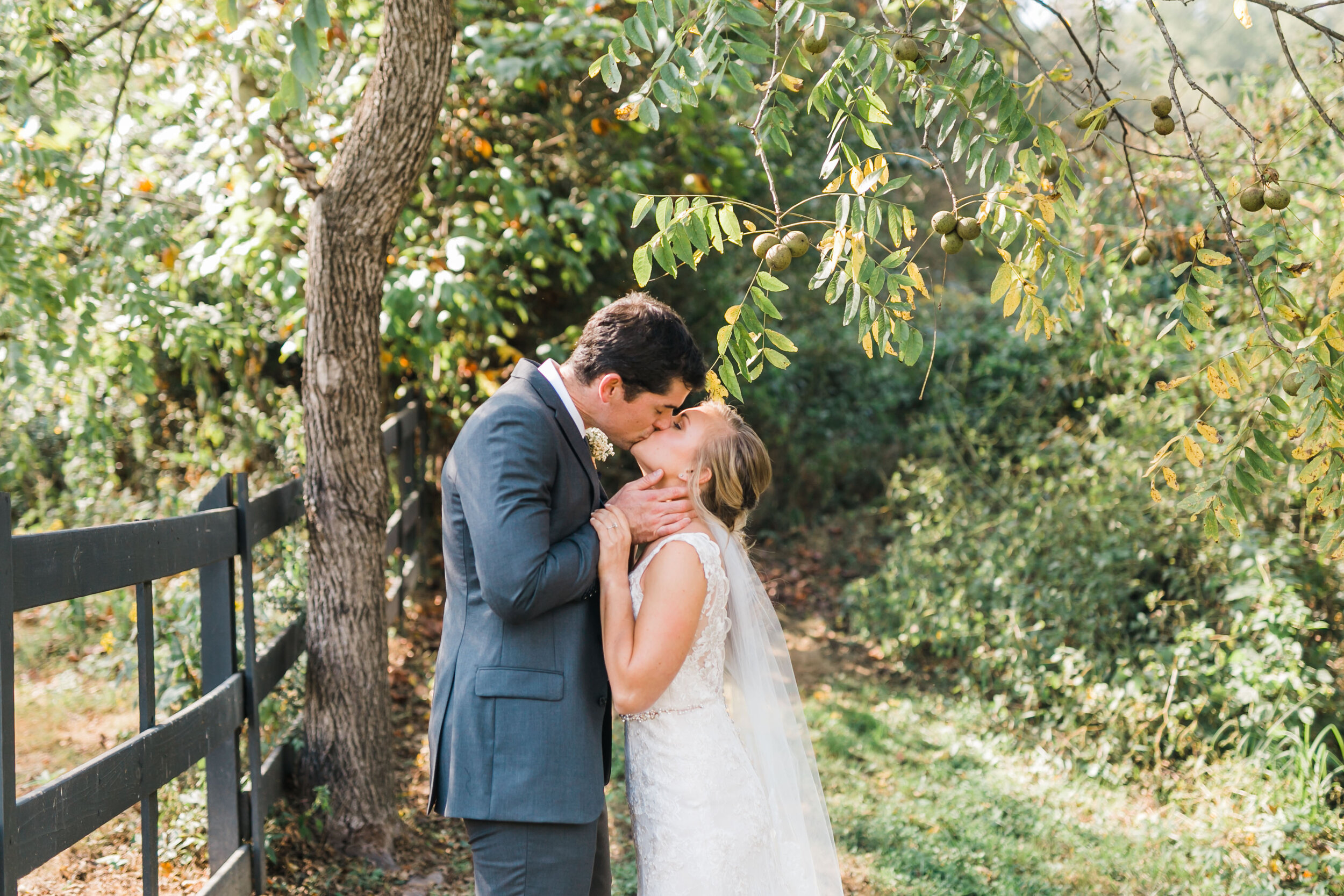bride and groom kissing 4 points farm