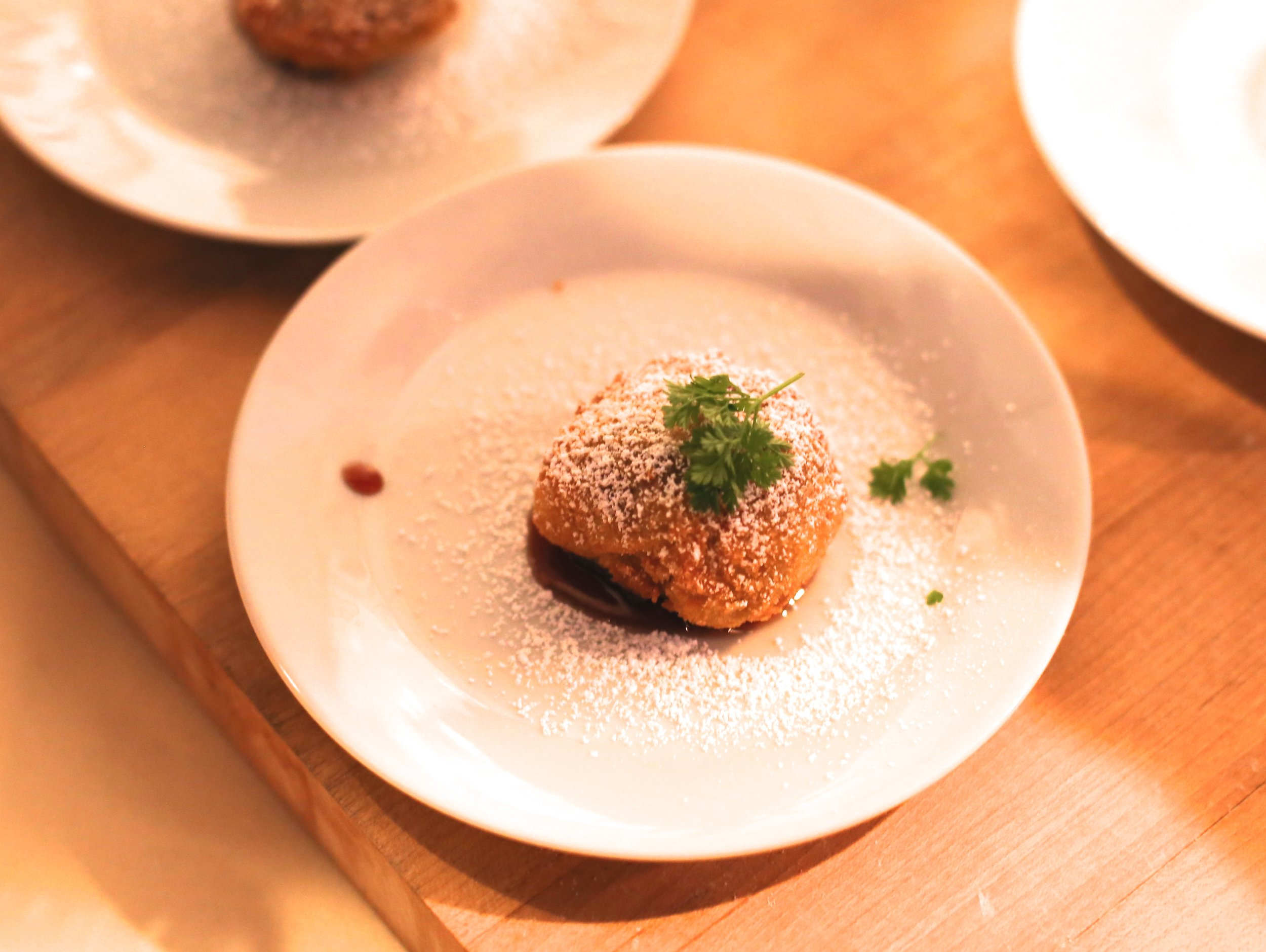 Deep fried foie gras croquettes with powdered chocolate, brandied cherries & black truffle. Chef Jason Paskewitz. The Blanchard. Chicago.