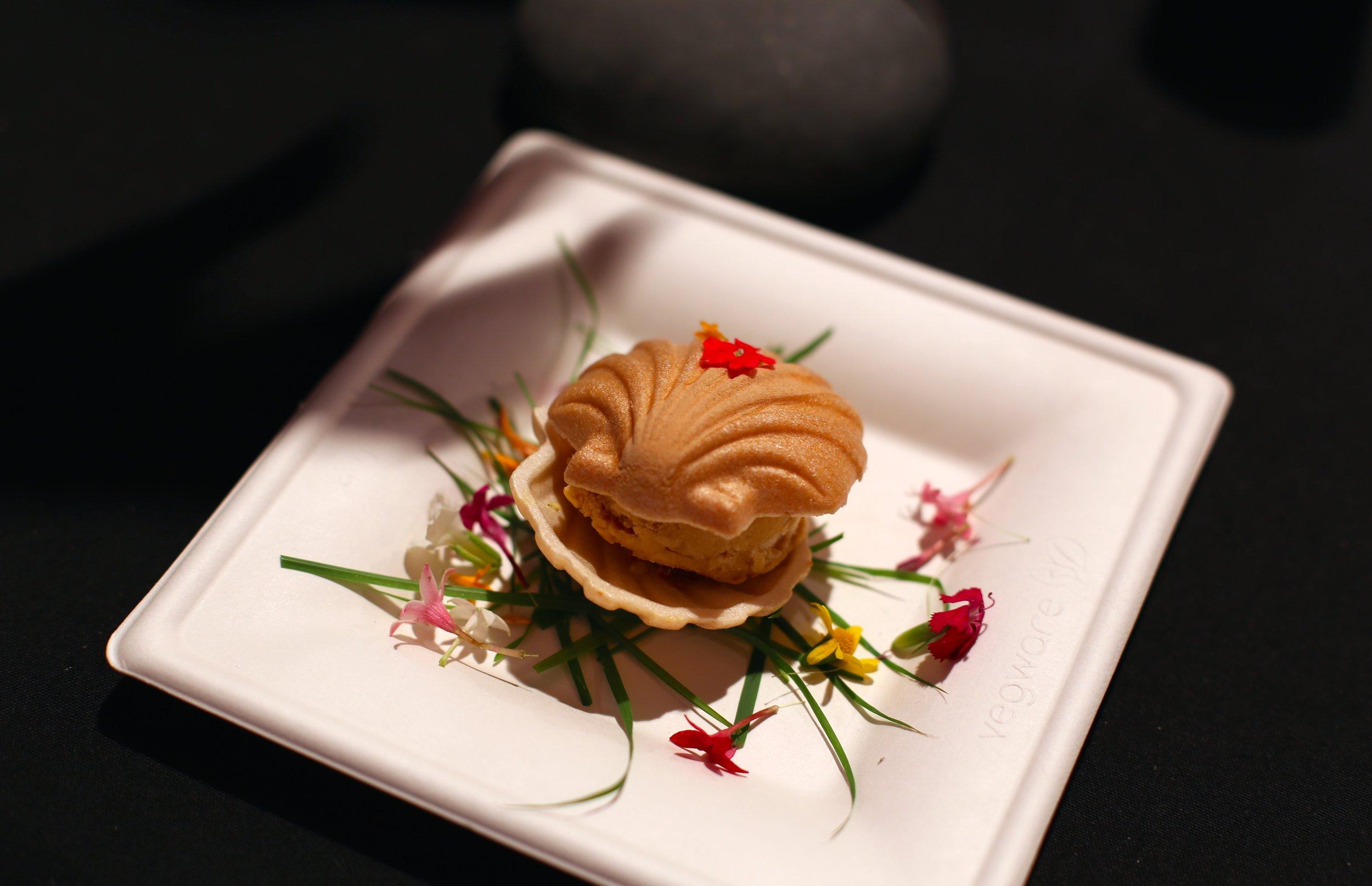 Sea urchin ice cream monaka. Sea urchin ice cream, almond cashew praline wafer cake, sweet ruby port soy, sea salt. Chaya Catering. Los Angeles.