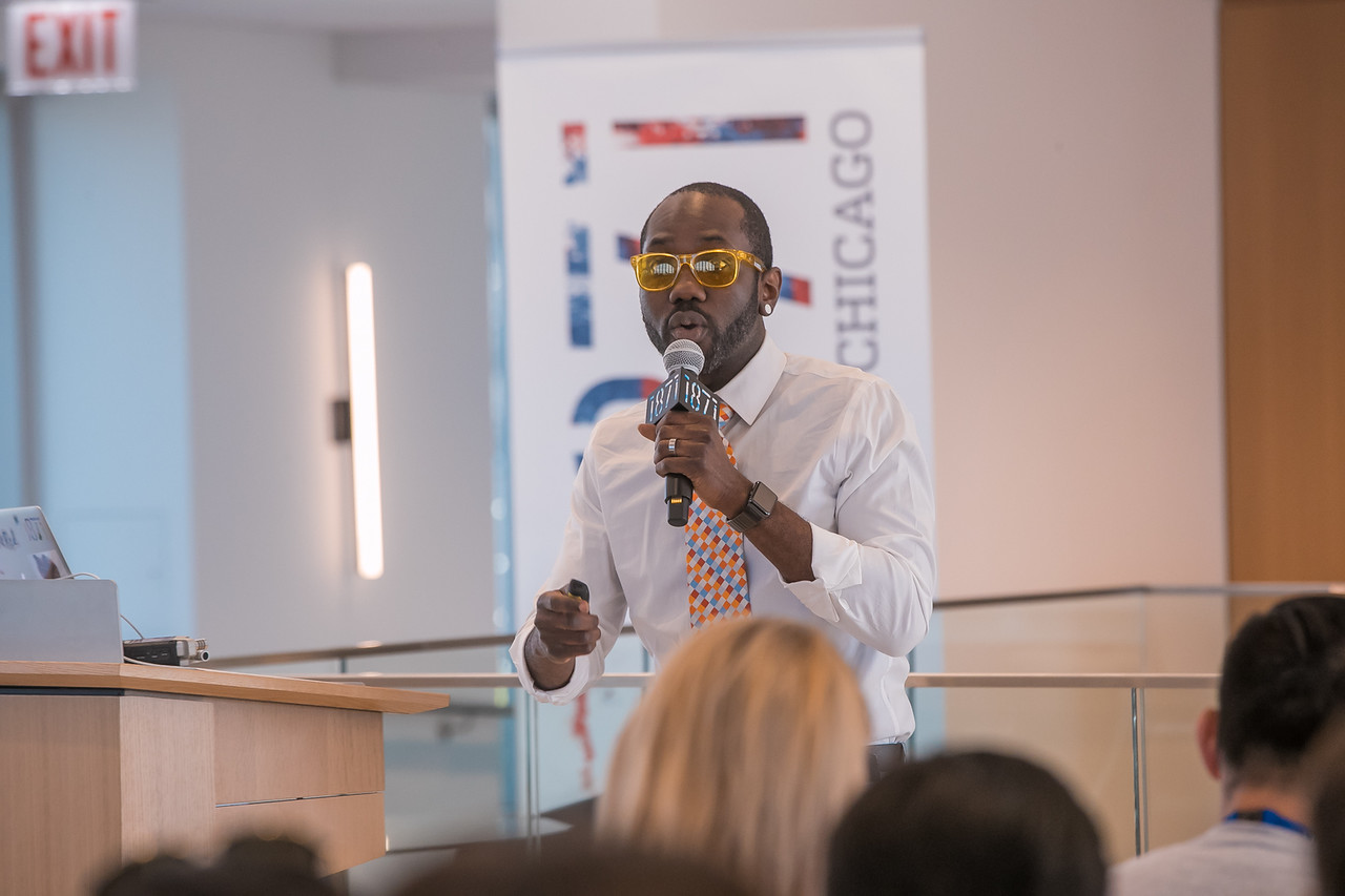 Mobolaji speaking to corporate leaders at 1871's AMP Corporate Showcase