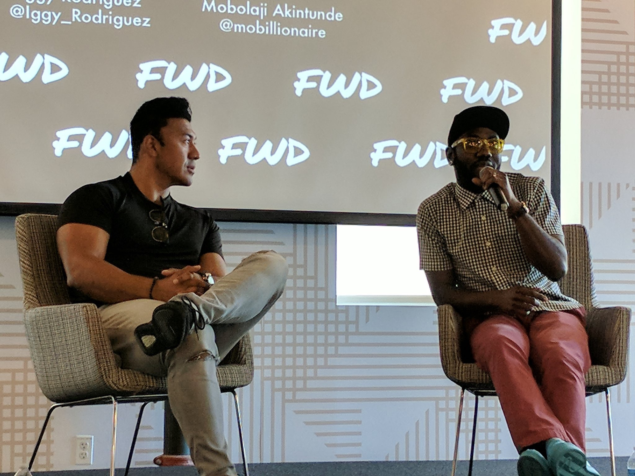 Mobolaji hosting fireside chat with Iggy Rodriguez at FWD Summit 2017.
