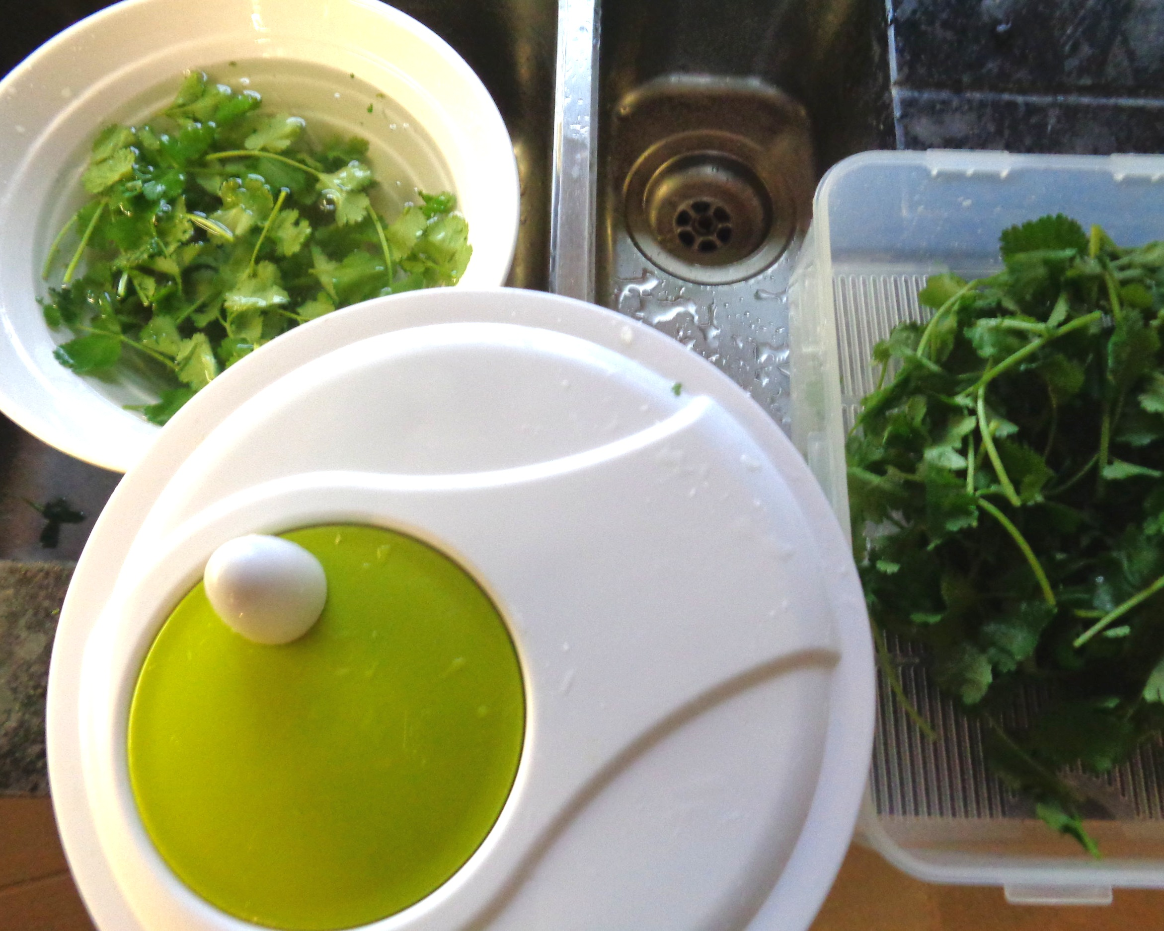 Use a salad spinner to dry your herbs then store them in a large airtight container, one that gives them lots of space. Also one with a raised base works especially well, keeping the herbs good for longer. Store in the fridge.