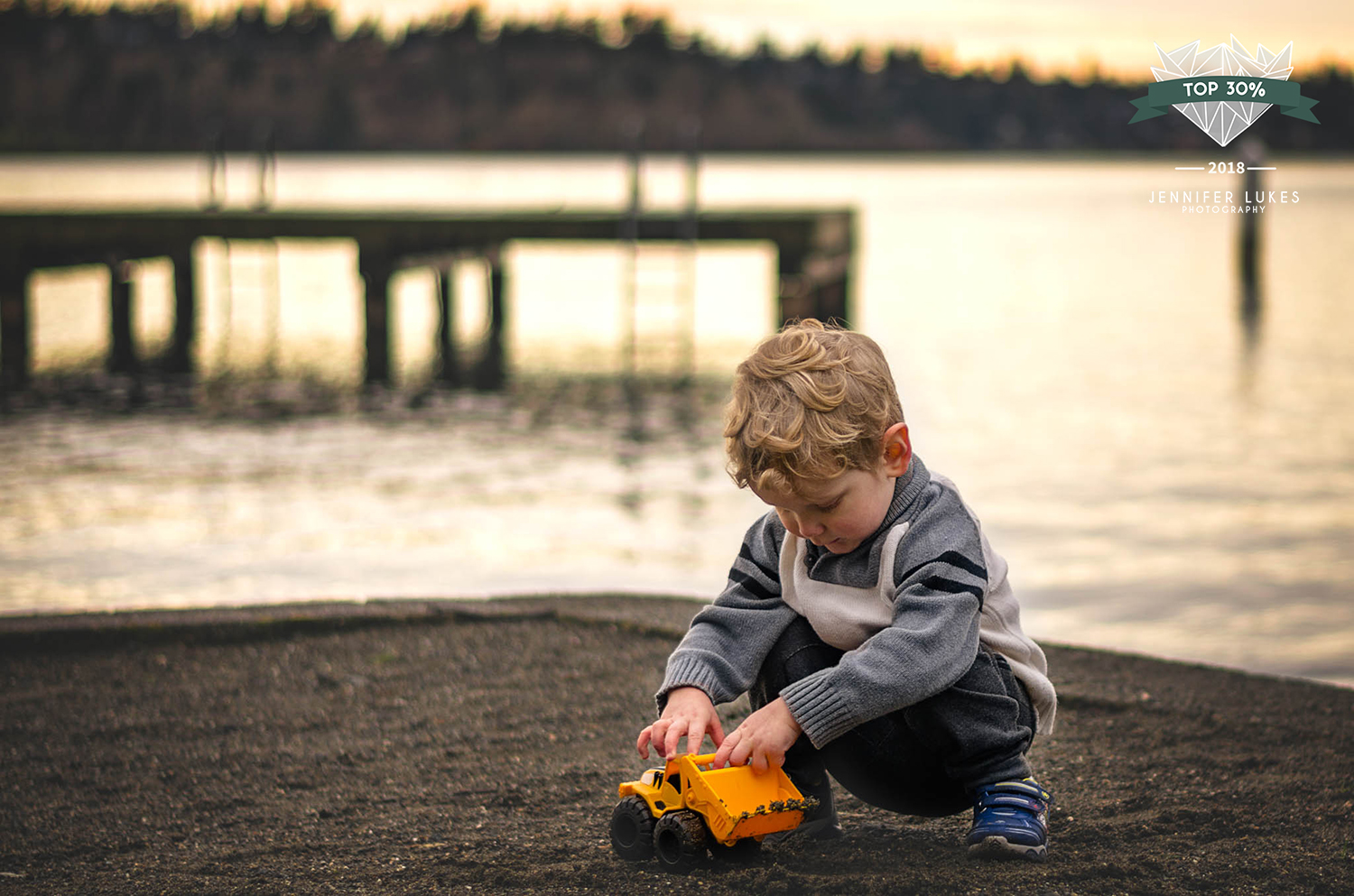 Top 30% award for baby and toddler photo of toddler playing with a bulldozer at Chism Beach in Bellevue, Washington.