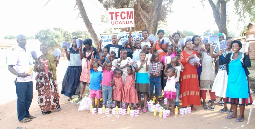 Robina and her granddaughters celebrate as they, with others are welcomed into the TFCM family