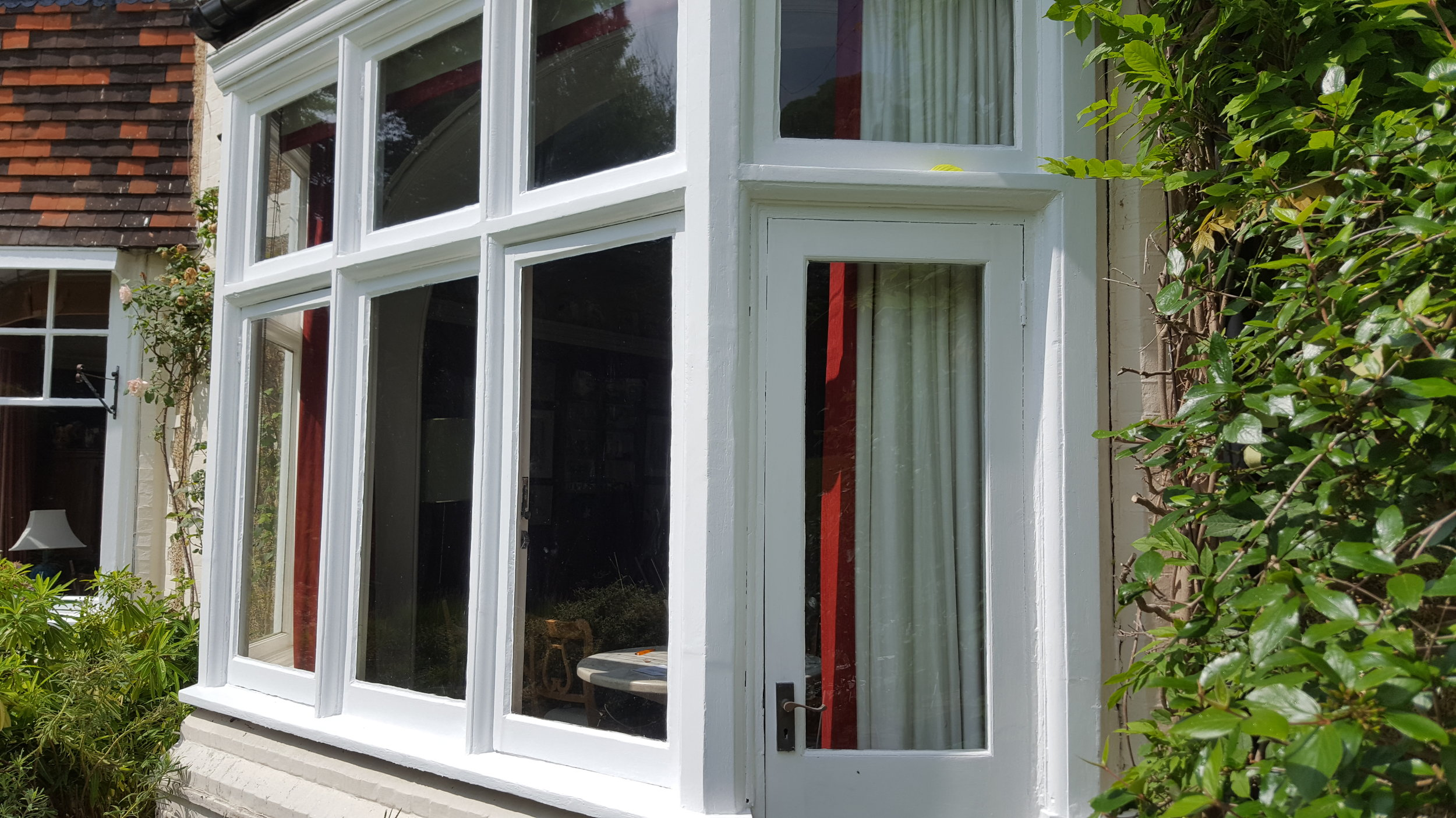 Windows AFTER fresh painting from Dorking Decorators