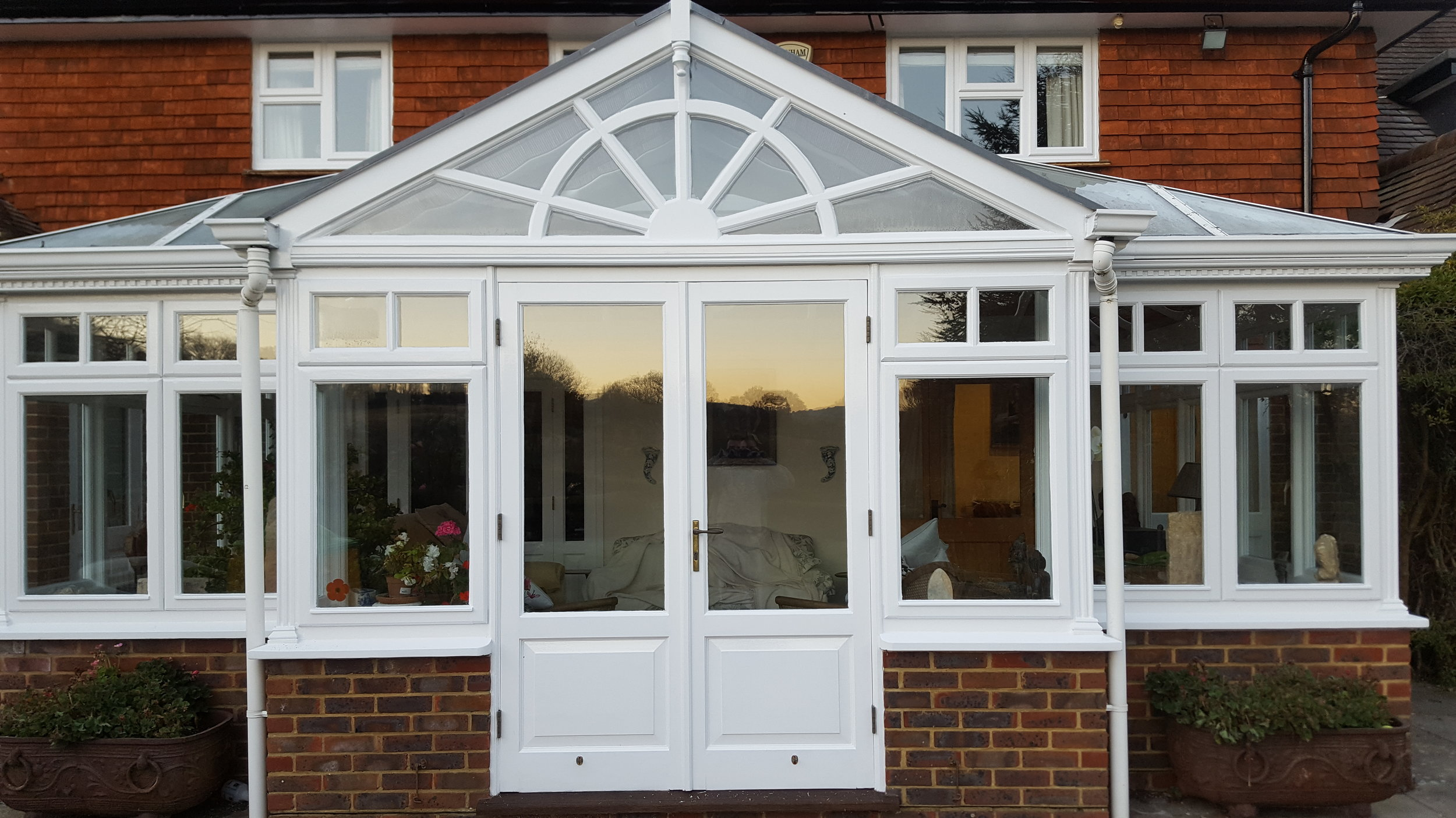 Conservatory and fascias painted by Dorking Decorators
