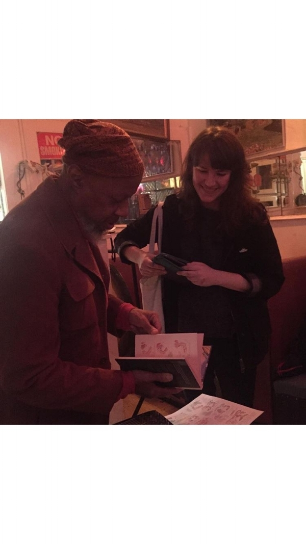 Laraaji with fan, comic artist and illustrator Leslie Stein, showing a comic she made featuring an illustration of him. .