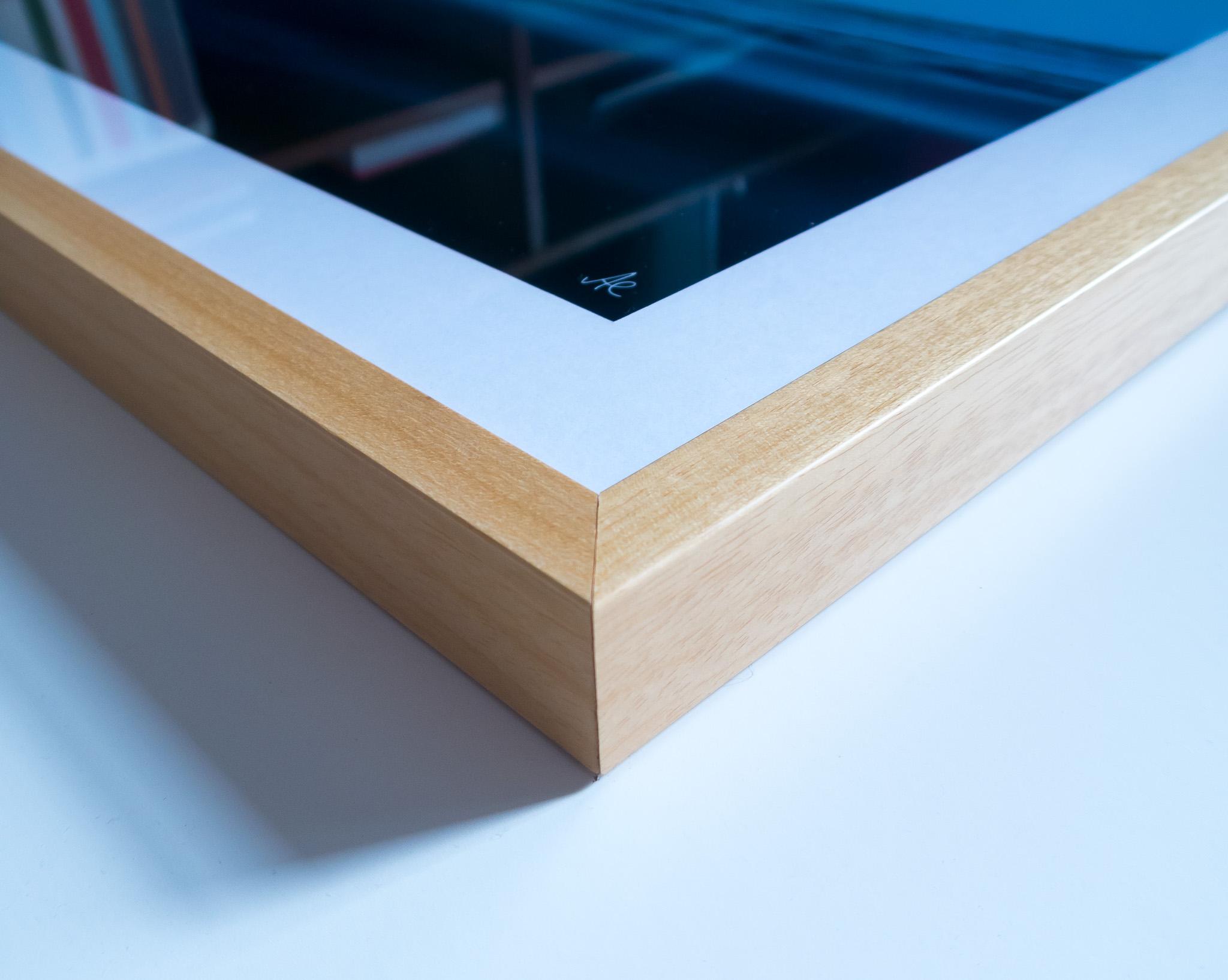 The corner of a framed print in beech.