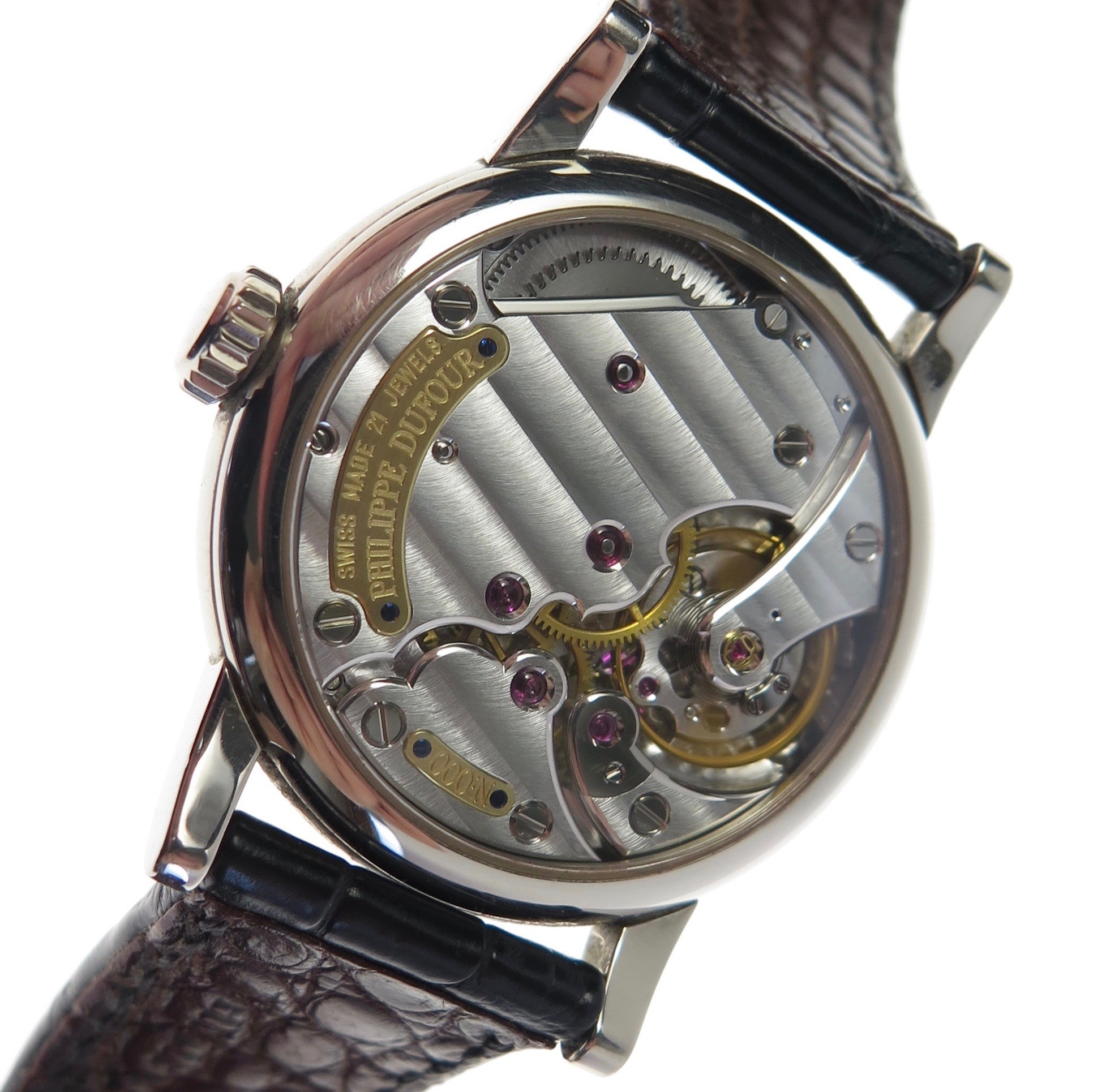 A view showing the fully assembled watch and the effect of the Geneva stripes brought to life by light. As the watch is moved light catches the Geneva stripes differently altering its aesthetic.