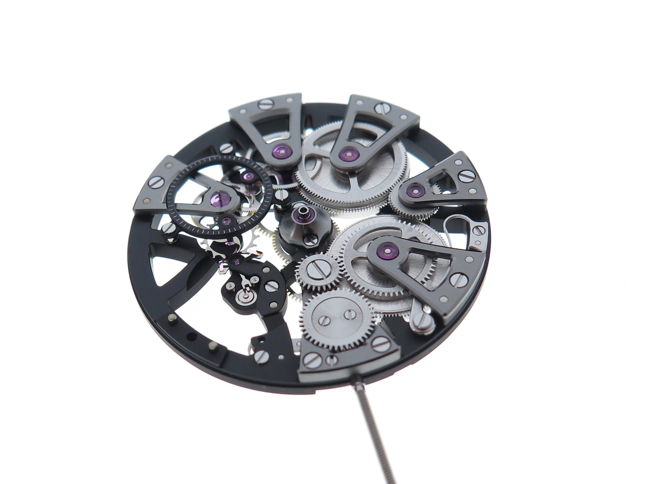 Balance and cock removed. Often the first part of the movement to be removed is the most delicate which is the escapement.