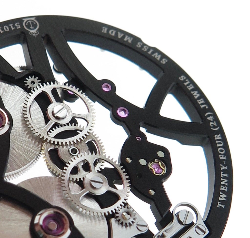 The twin wheels. The higher wheel drives the gearing for the hands. The lower links to the setting to adjust the time manually.