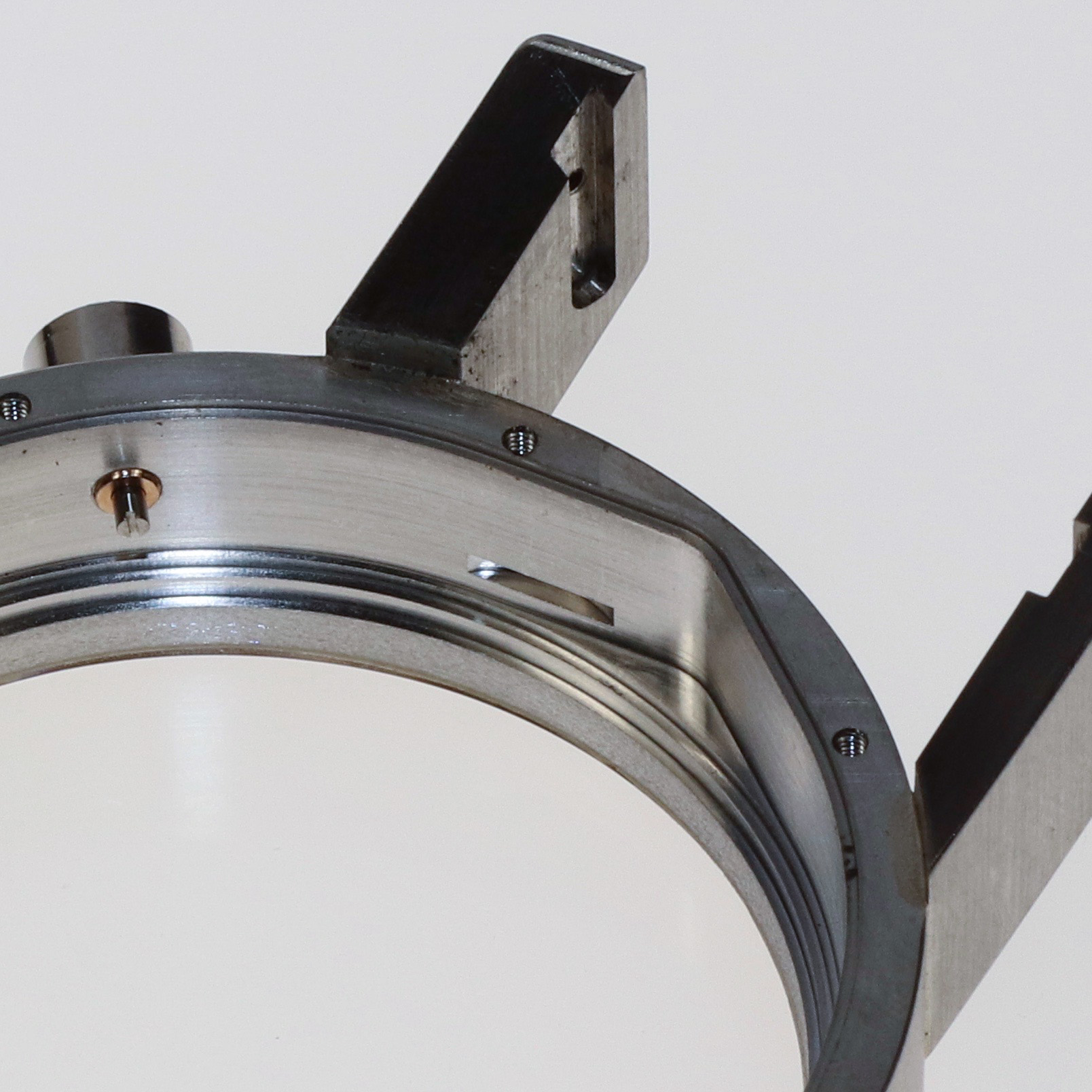 The cut out in the centre of the case is for the movement clamp allowing the movement to be tightly held inside once assembled