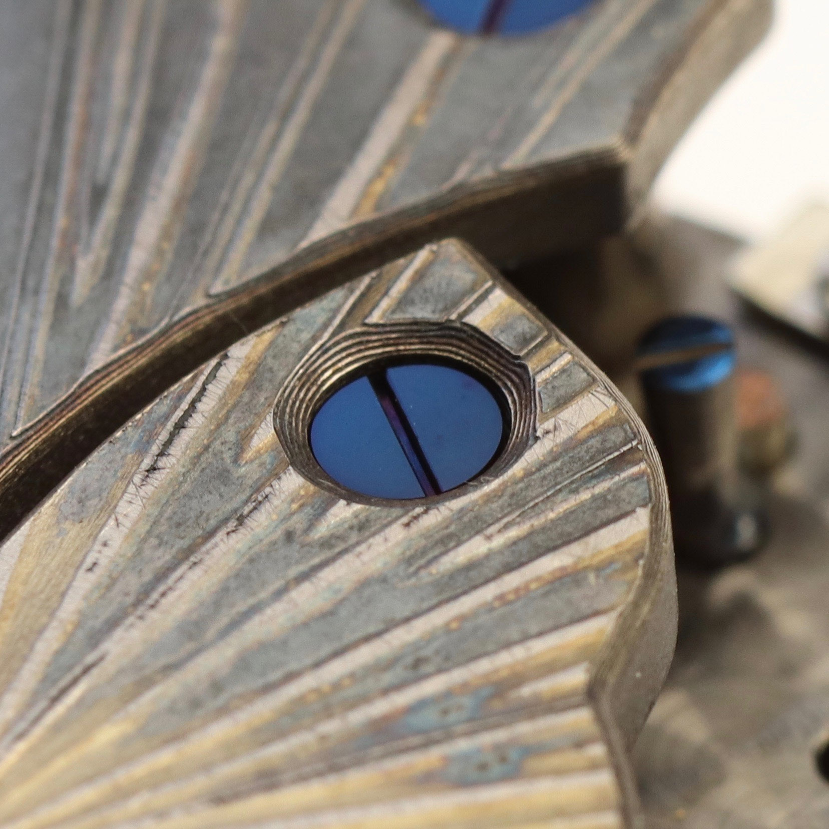 Close up of angling around the screw hole showing the multiple levels of the mokame gane