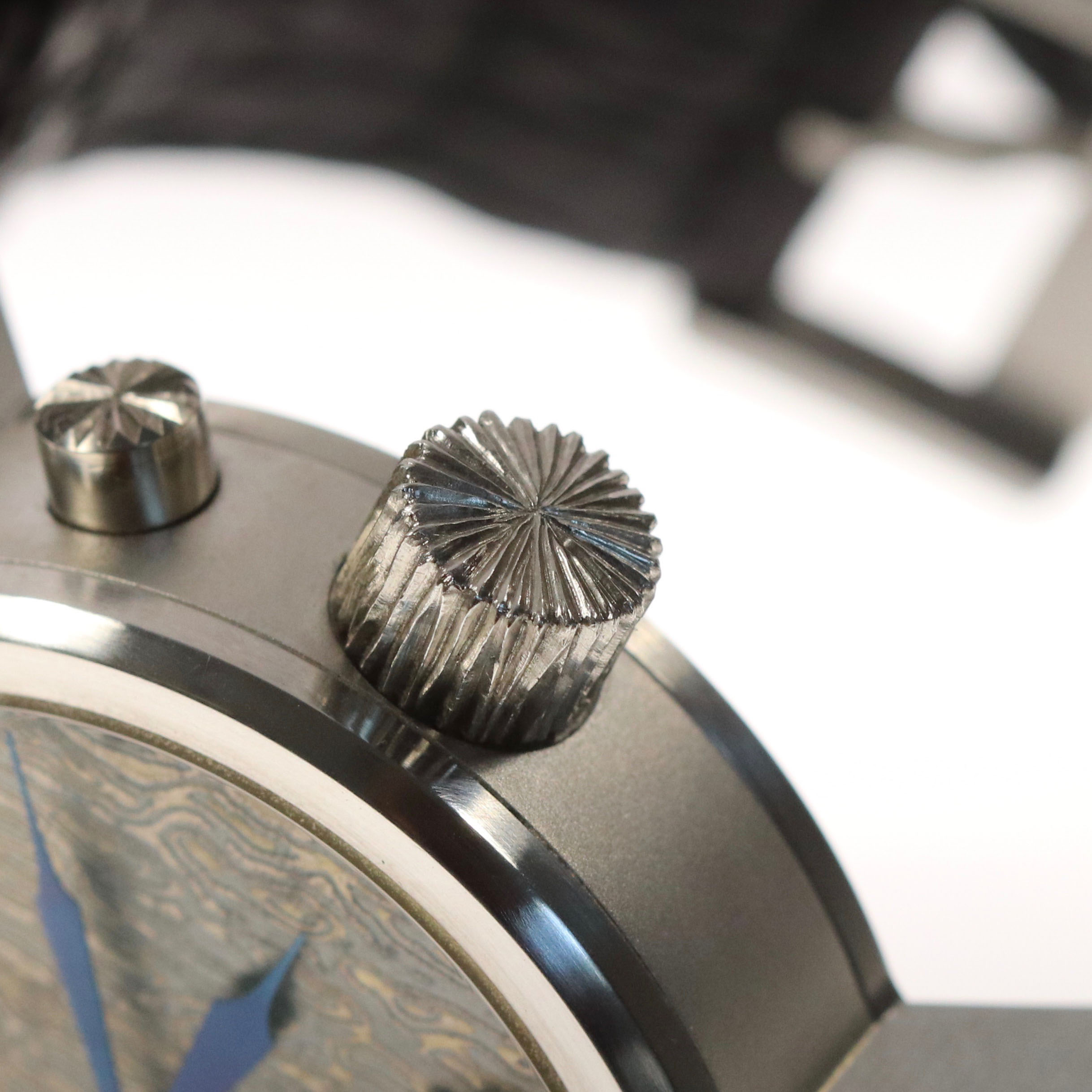 The winding crown also follows the same wood effect hand engraved as the pusher