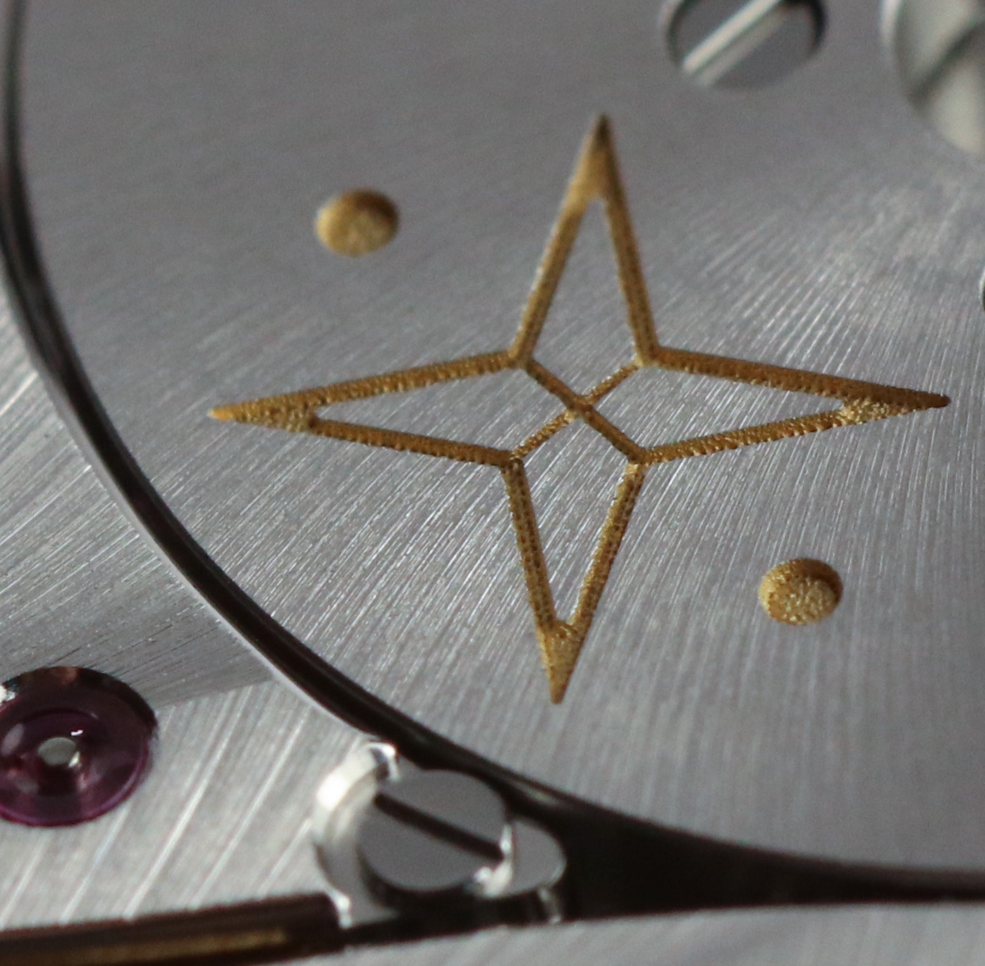 The Vaucher logo chemically etched into the tungsten rotor weight