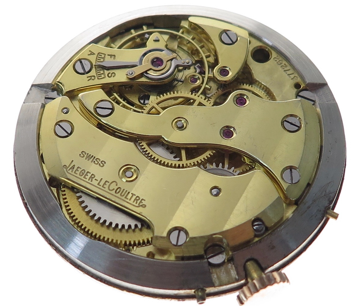 Full view of the caliber in its movement ring which in turn pushes with a friction fit into the case back followed by the case bezel which clips onto the back.
